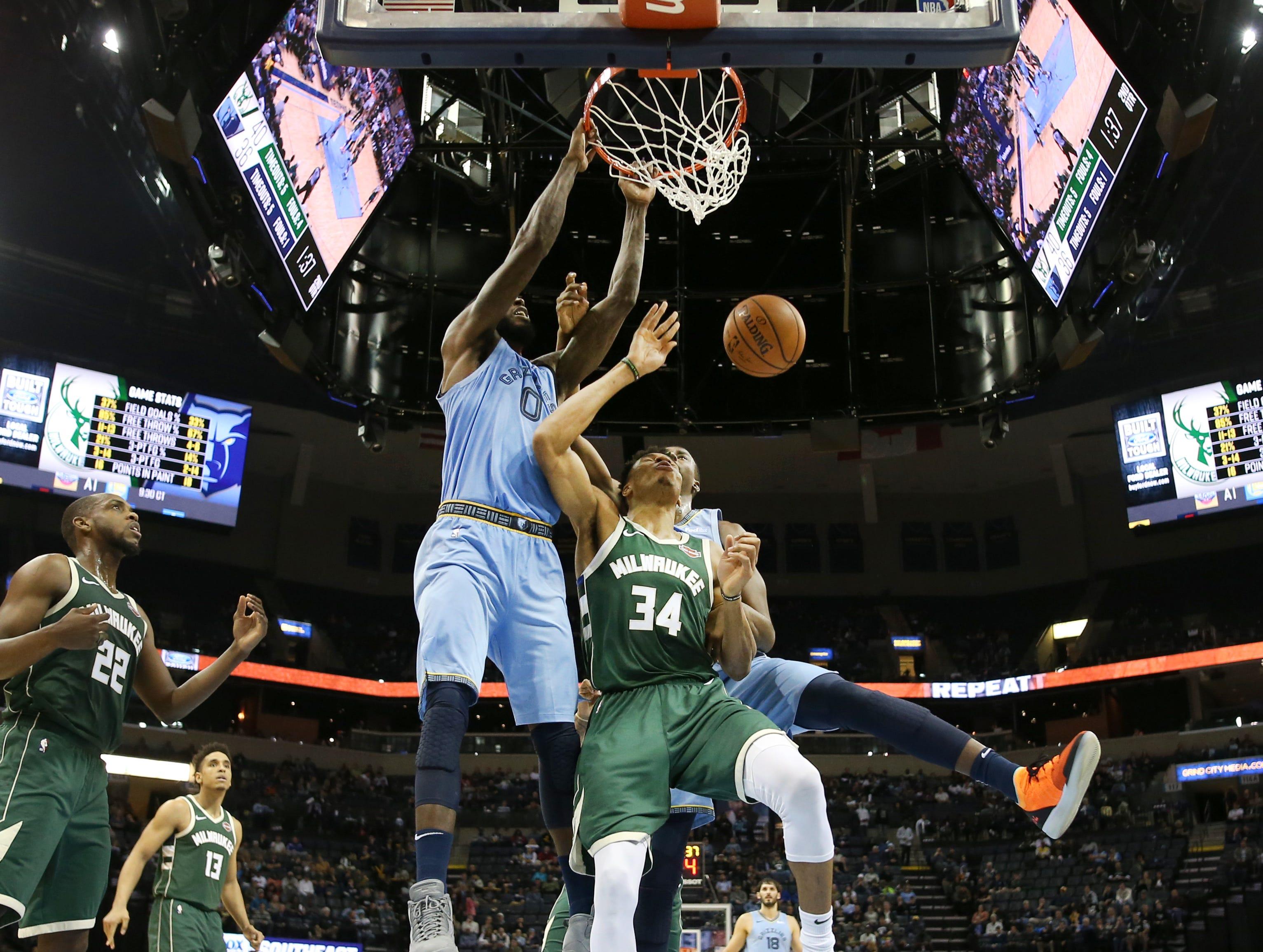 Memphis Grizzlies forward JaMychal Green dunks the ball against the Milwaukee Bucks forward Giannis Antetokounmpo during their game at the FedExForum on Wednesday, Jan. 16, 2019.