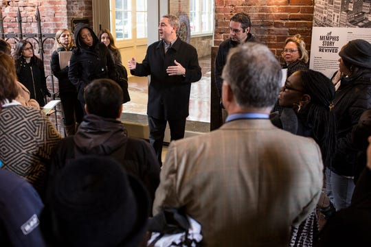 January 17 2019 - Adam Slovis, center, speaks at the Tennessee Brewery during a bus tour hosted by the Downtown Memphis Commission. During the tour the Downtown Memphis Commission gave updates on many of the projects involved in downtown Memphis.