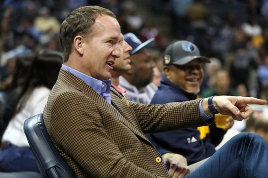 Former NFL and Tennessee Vols quarterback Peyton Manning watches as the Memphis Grizzlies take on the Milwaukee Bucks at the FedExForum on Wednesday, Jan. 16, 2019.
