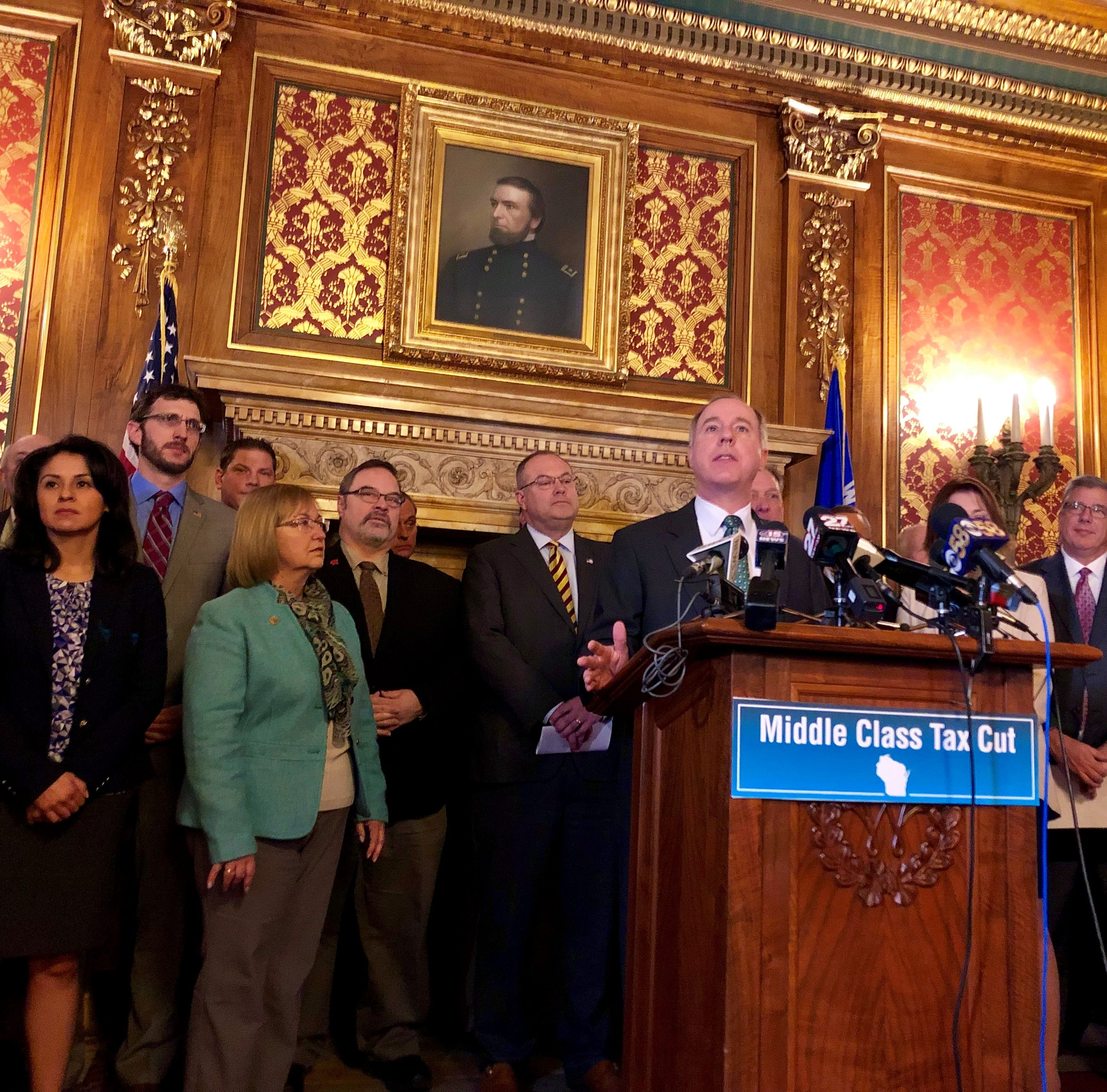 Tony Evers and Republican lawmakers battle over taxes, health coverage
