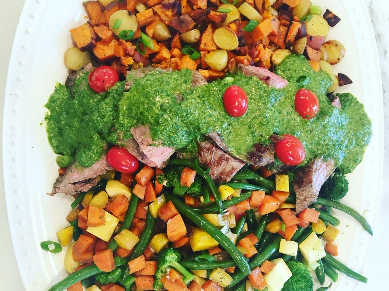 Chimichurri grilled steak with roasted vegetable hash, from the SimpleEats MKE blog, makes for an attractive platter.