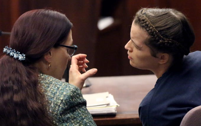 Melissa Sandrone, who shot an employee at M&M Motors in West Allis on March 18, 2018, consults with Atty. Victoria McCandless during a court session on Jan. 17 where she was found not guilty by reason of mental defect. Sandrone remains in custody pending evaluation for mental health treatment placement.
