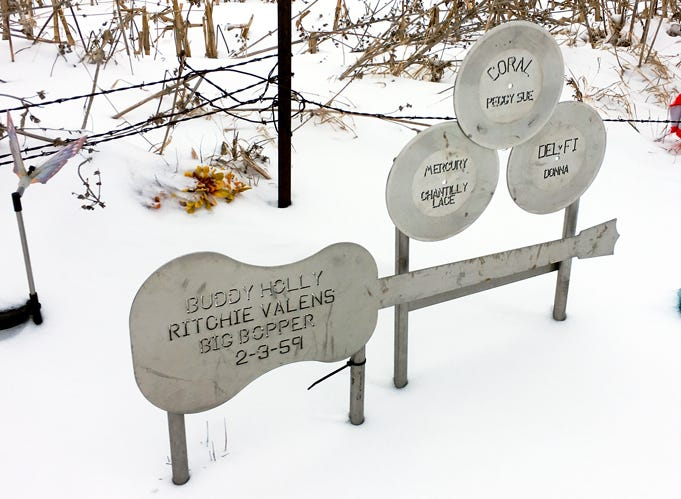 Stainless steel cutouts of a guitar and three LP records, each inscribed with a song title, mark the site of a plane crash outside Clear Lake, Iowa, that killed Buddy Holly, The Big Bopper, Ritchie Valens and the pilot.