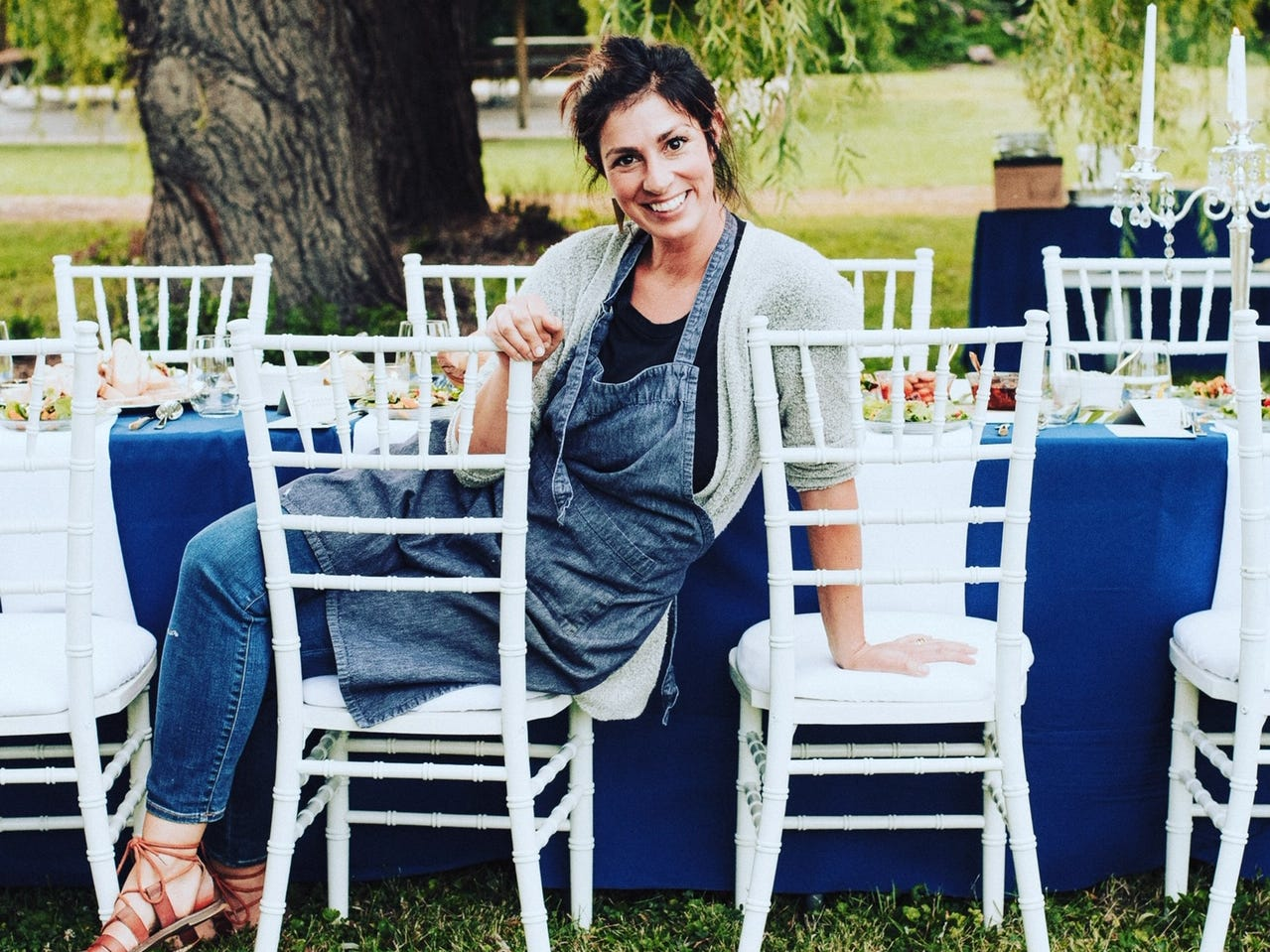 Krysta Hutton poses while setting up a murder mystery party she catered.