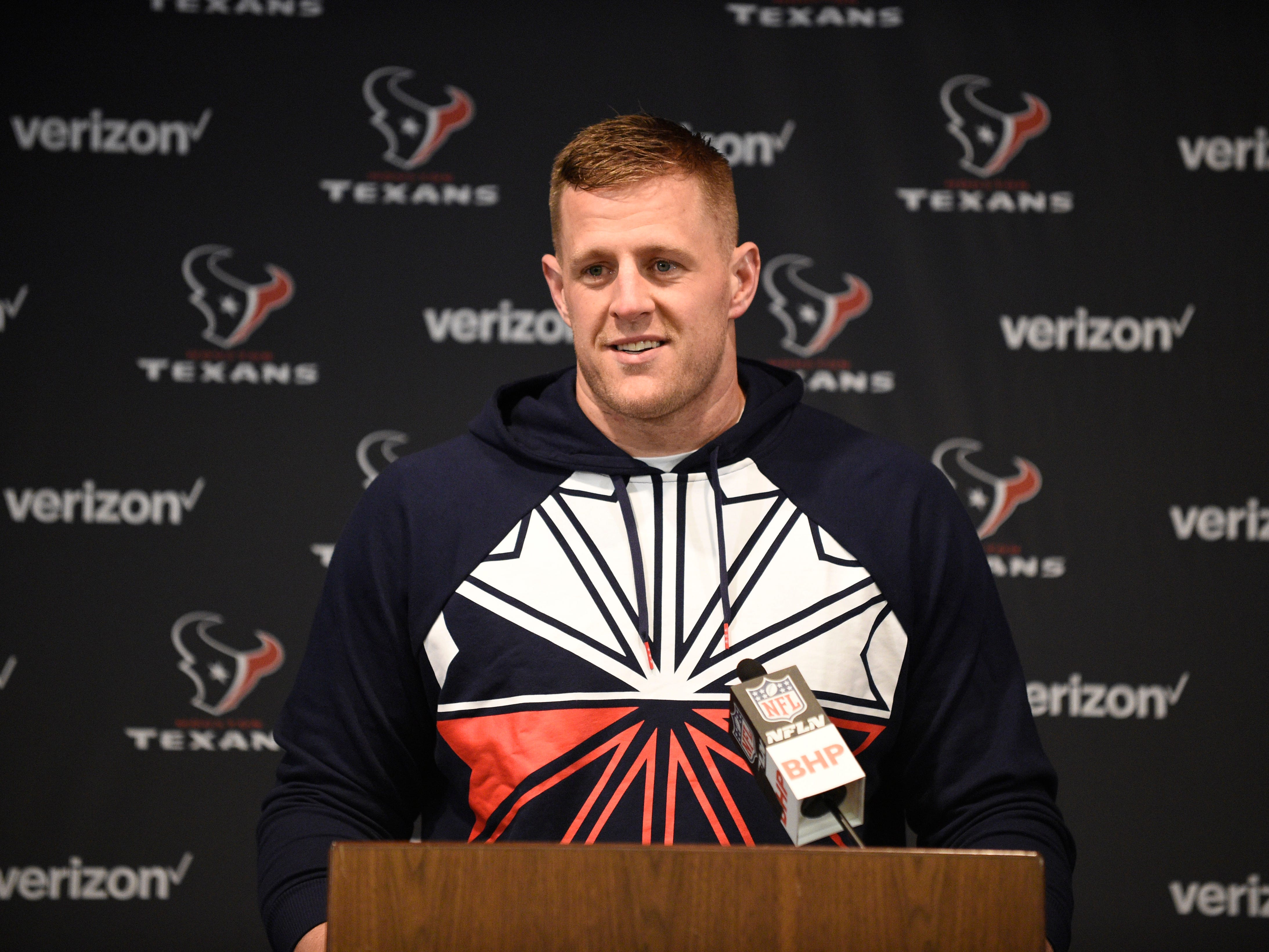 Houston Texans defensive end J.J. Watt talks with the media following a game against the Dallas Cowboys, Sunday, Oct. 7, 2018, in Houston.