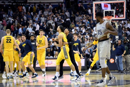 Marquette celebrates its 74-71 victory over Georgetown on Tuesday.