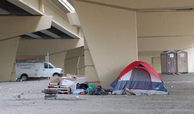 """Homeless people in Milwaukee have been setting up camp at what they call """"Tent City,"""" under the I-794 overpass at North 6th and West Clybourn streets."""