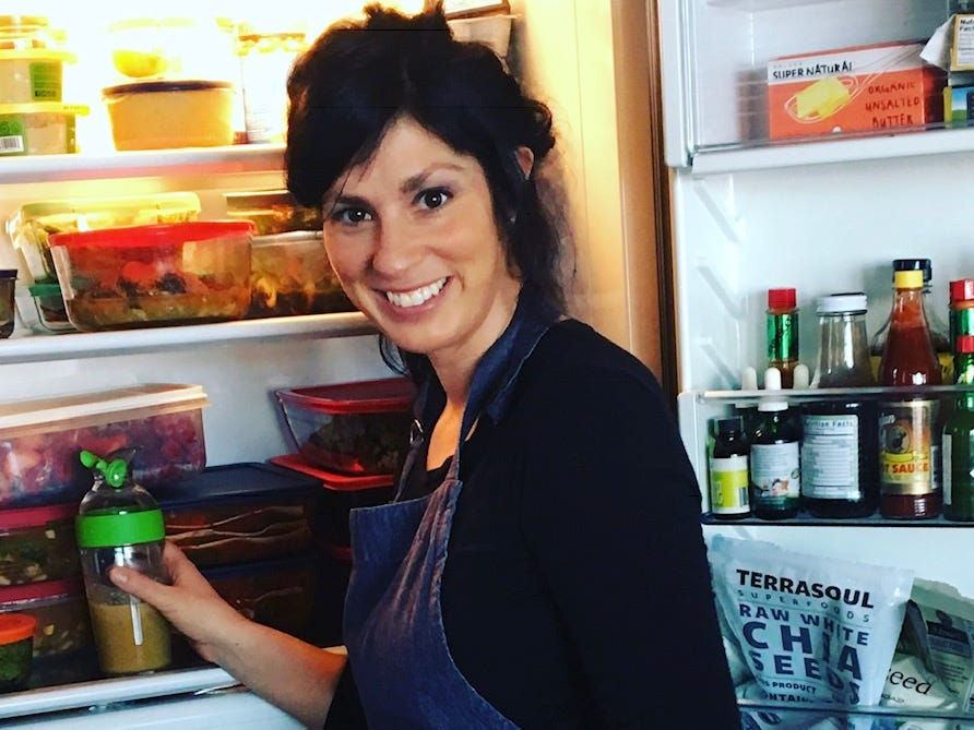 Krysta Hutton, founder of SimpleEats MKE, stocks a client's refrigerator.