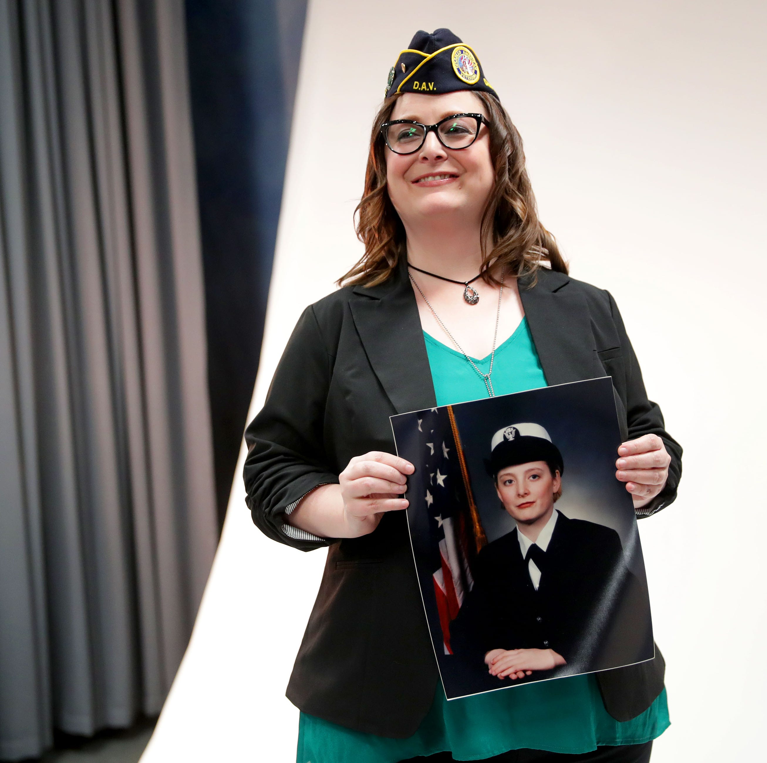 No, they're not invisible anymore. New photo exhibit puts a face on women veterans