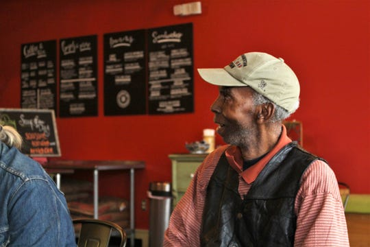 Selma Williams meets with his friends at Cafe Louisa each morning. They have named him the Mayor of Cloverdale.