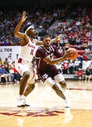 Jan 12, 2019; Tuscaloosa, AL, USA; Texas A&M Aggies guard Savion Flagg (1) drives to the basket against Alabama Crimson Tide guard Herbert Jones (10) during the first half at Coleman Coliseum. Mandatory Credit: Marvin Gentry-USA TODAY Sports