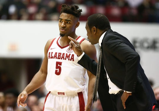 Jan 12, 2019; Tuscaloosa, AL, USA; Alabama Crimson Tide head coach Avery Johnson talks to Alabama Crimson Tide guard Avery Johnson Jr. (5) during the second half against Texas A&M Aggies at Coleman Coliseum. Mandatory Credit: Marvin Gentry-USA TODAY Sports
