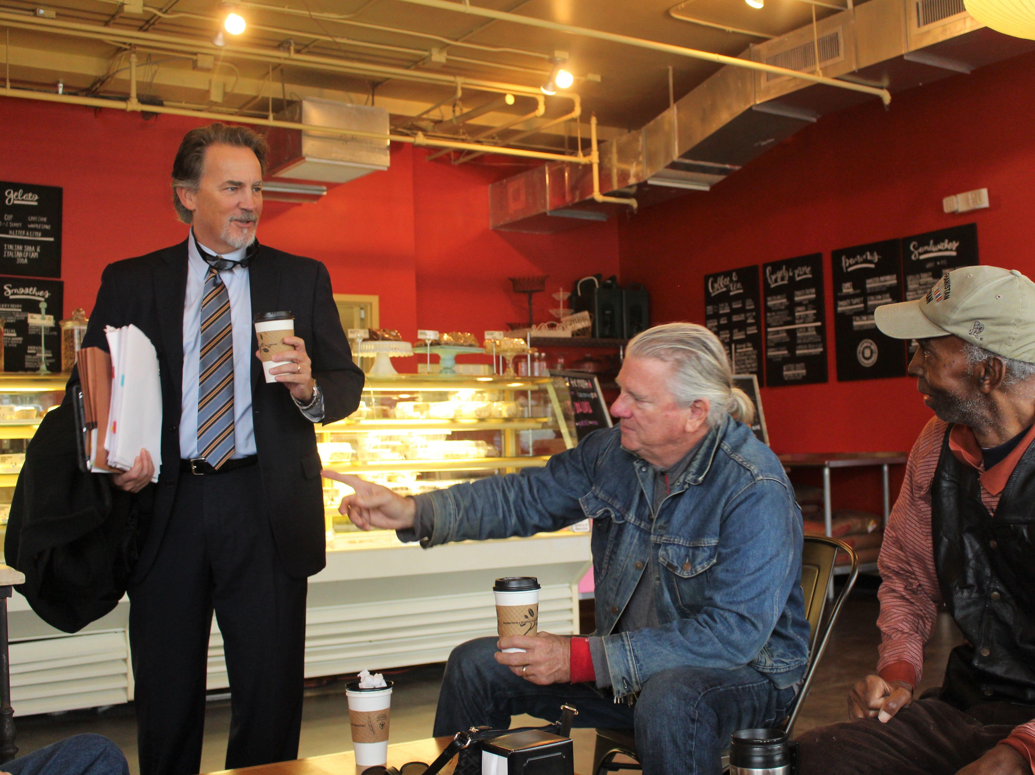Jay Hinton, Arnie Burris and Selma Williams talk over coffee at Cafe Louisa on Jan. 17, 2019.