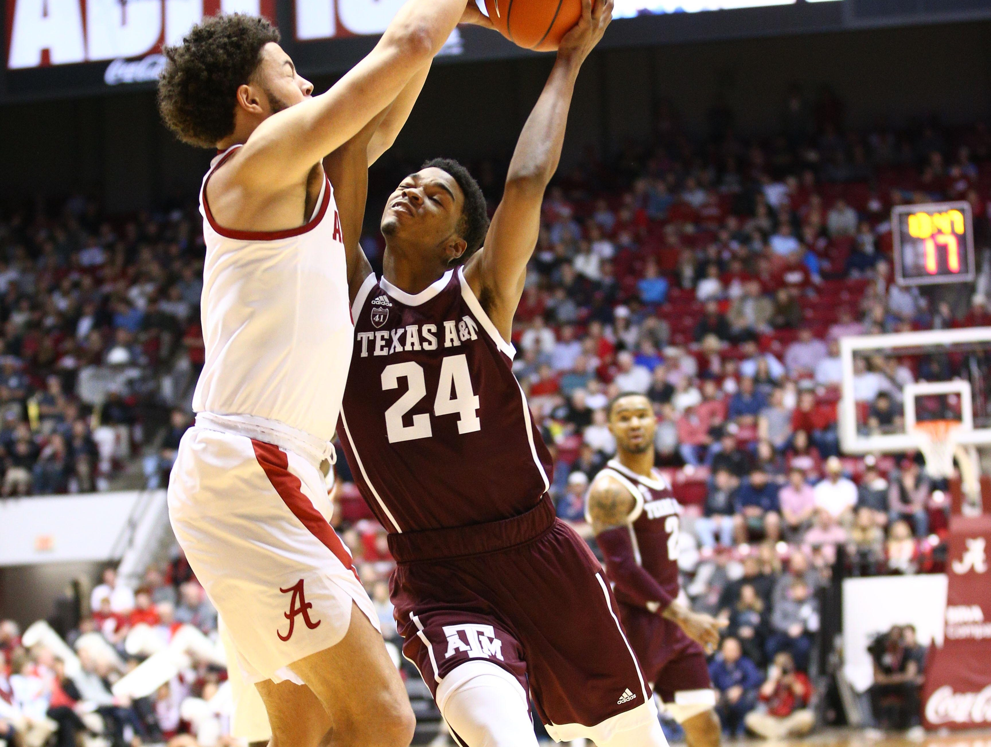 Jan 12, 2019; Tuscaloosa, AL, USA; Texas A&M Aggies forward John Walker III (24) shoots against Alabama Crimson Tide forward Alex Reese (3) during the first half at Coleman Coliseum. Mandatory Credit: Marvin Gentry-USA TODAY Sports