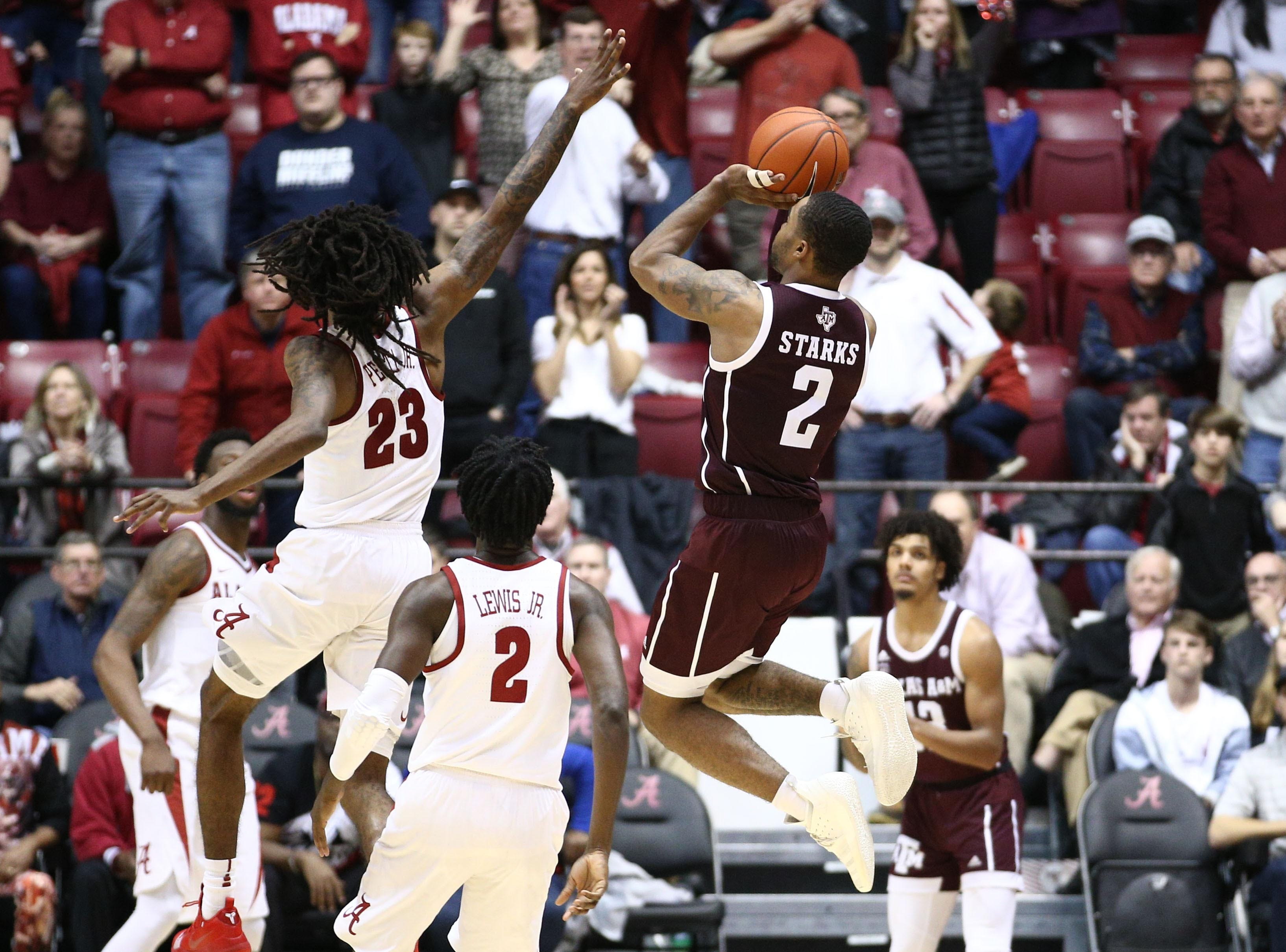 Jan 12, 2019; Tuscaloosa, AL, USA; Texas A&M Aggies guard TJ Starks (2) makes a shot as time expires as Alabama Crimson Tide guard John Petty (23) defends during the second half at Coleman Coliseum. Mandatory Credit: Marvin Gentry-USA TODAY Sports