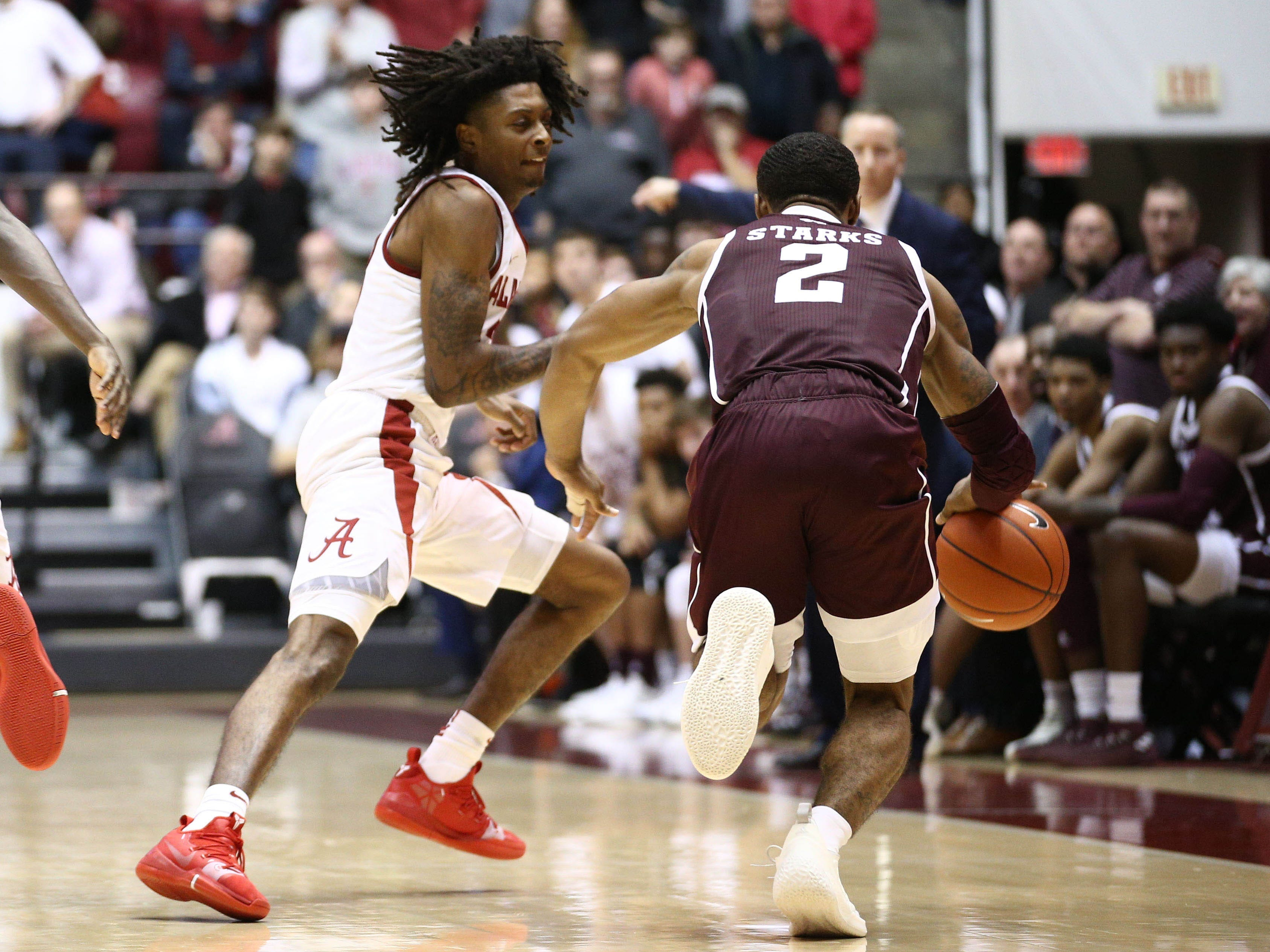 Jan 12, 2019; Tuscaloosa, AL, USA; Texas A&M Aggies guard TJ Starks (2) brings the ball down the court in the final seconds as Alabama Crimson Tide guard John Petty (23) defends during the second half at Coleman Coliseum. Mandatory Credit: Marvin Gentry-USA TODAY Sports