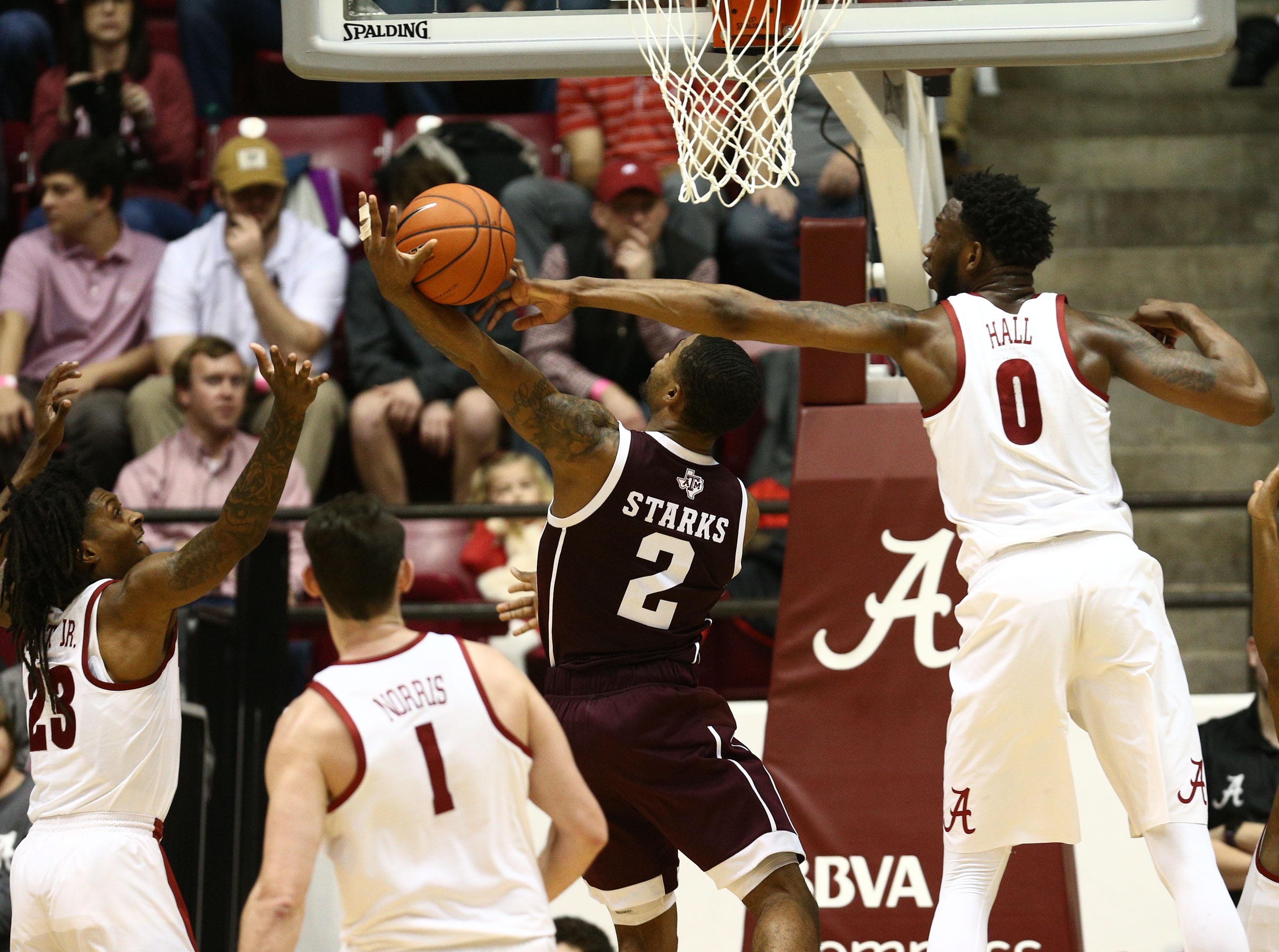 Jan 12, 2019; Tuscaloosa, AL, USA; Alabama Crimson Tide forward Donta Hall (0) blocks the shot of Texas A&M Aggies guard TJ Starks (2) during the second half at Coleman Coliseum. Mandatory Credit: Marvin Gentry-USA TODAY Sports