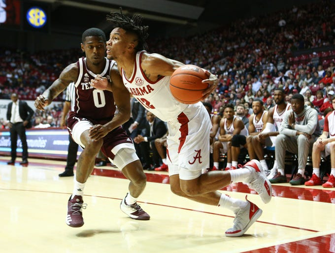 Jan 12, 2019; Tuscaloosa, AL, USA; Alabama Crimson Tide guard Dazon Ingram (12) drives to the basket against Texas A&M Aggies guard Jay Jay Chandler (0) during the second half at Coleman Coliseum. Mandatory Credit: Marvin Gentry-USA TODAY Sports