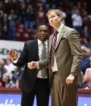 Jan 12, 2019; Tuscaloosa, AL, USA; Alabama Crimson Tide head coach Avery Johnson talks to assistant John Pelphrey during the second half at Coleman Coliseum. Mandatory Credit: Marvin Gentry-USA TODAY Sports