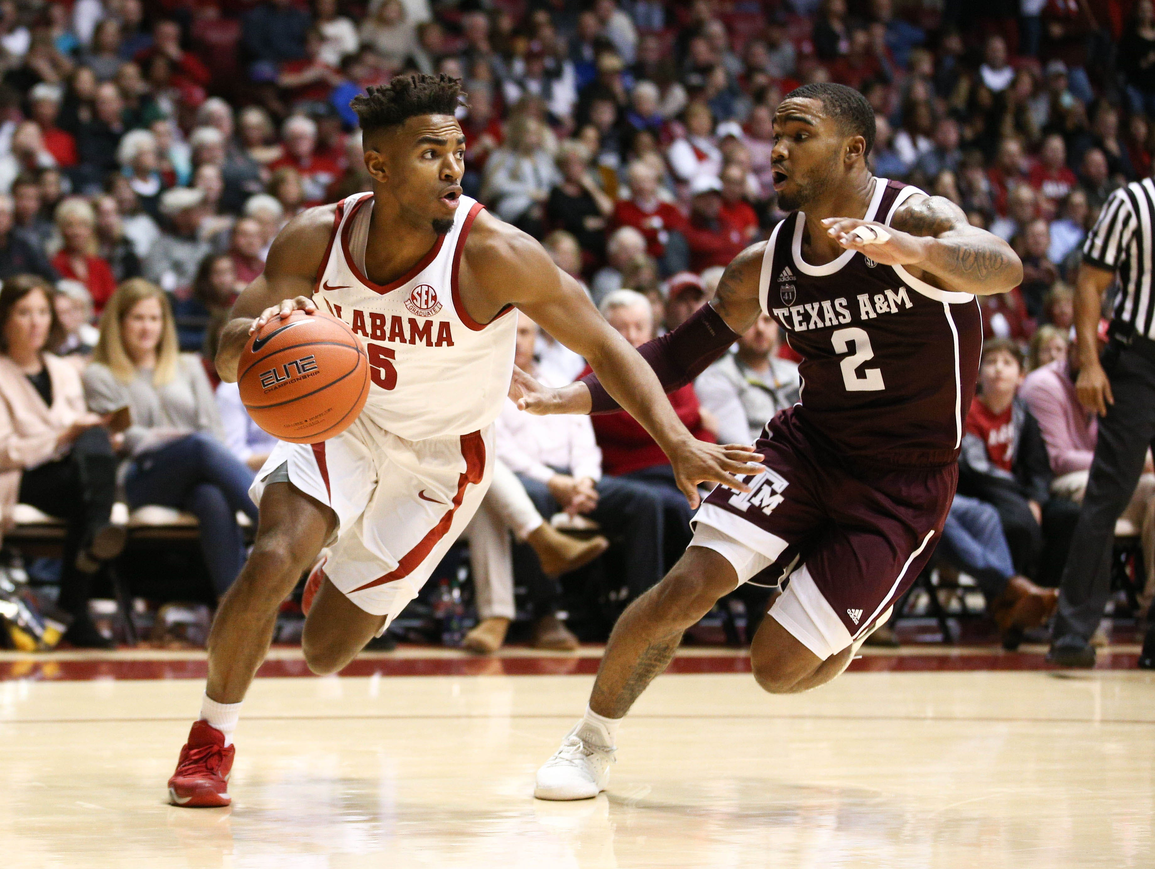 Jan 12, 2019; Tuscaloosa, AL, USA; Alabama Crimson Tide guard Avery Johnson Jr. (5) controls the ball as Texas A&M Aggies guard TJ Starks (2) defends during the second half at Coleman Coliseum. Mandatory Credit: Marvin Gentry-USA TODAY Sports
