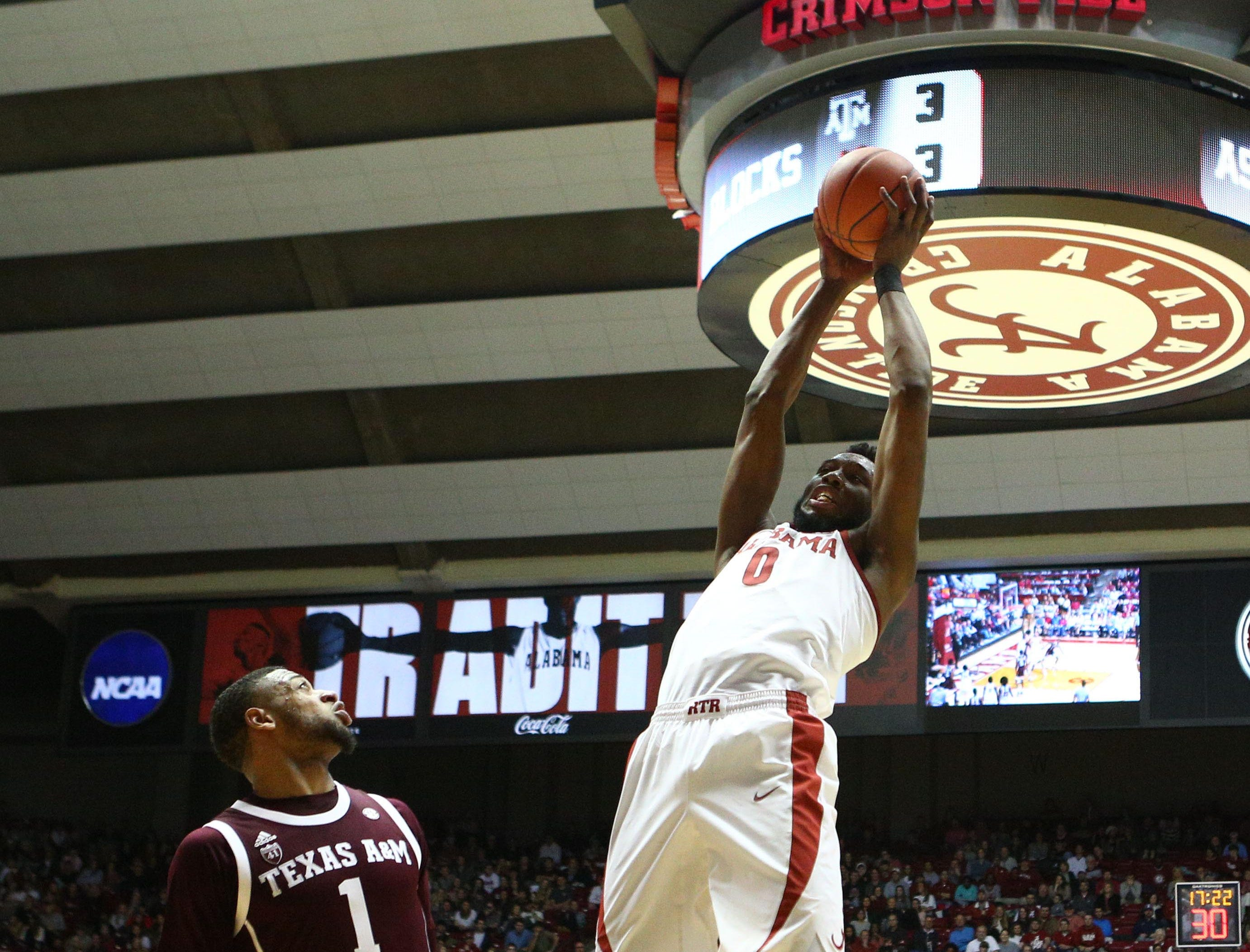 Jan 12, 2019; Tuscaloosa, AL, USA; Alabama Crimson Tide forward Donta Hall (0) grabs a rebound against Texas A&M Aggies during the second half at Coleman Coliseum. Mandatory Credit: Marvin Gentry-USA TODAY Sports