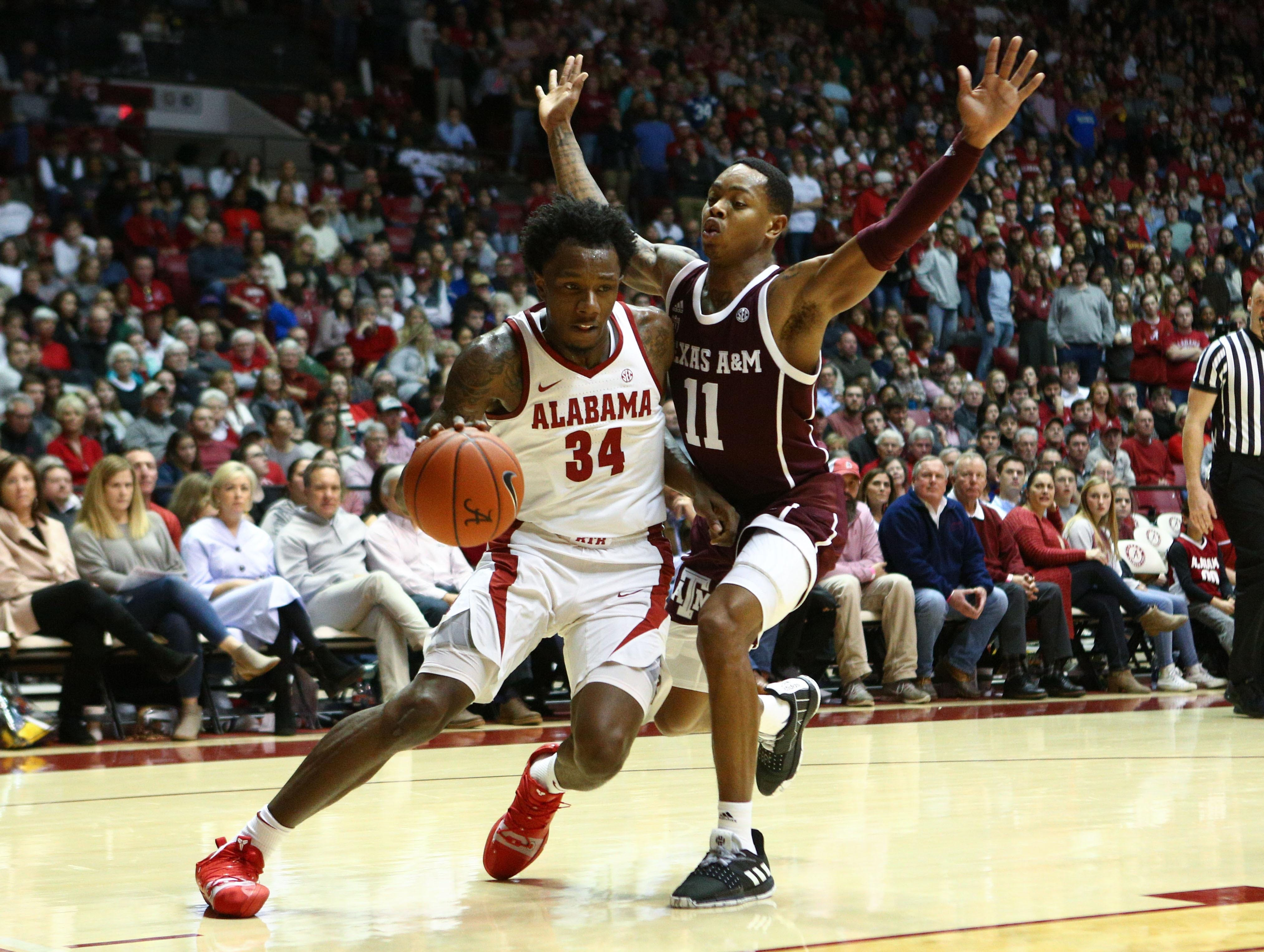 Jan 12, 2019; Tuscaloosa, AL, USA; Alabama Crimson Tide guard Tevin Mack (34) drives to the basket against Texas A&M Aggies guard Wendell Mitchell (11) during the second half at Coleman Coliseum. Mandatory Credit: Marvin Gentry-USA TODAY Sports