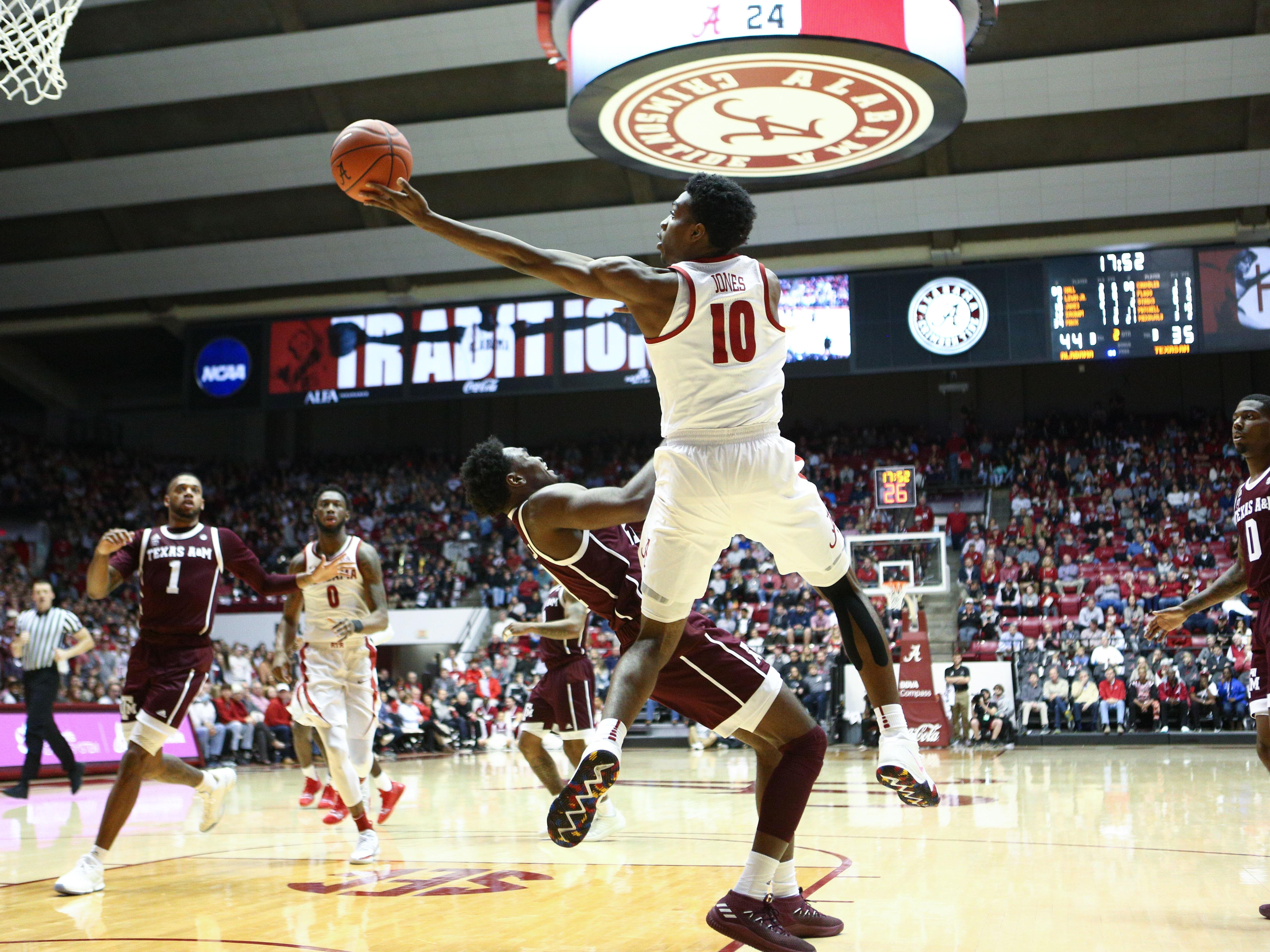 Jan 12, 2019; Tuscaloosa, AL, USA; Alabama Crimson Tide guard Herbert Jones (10) goes to the basket against Texas A&M Aggies forward Christian Mekowulu (21) during the second half at Coleman Coliseum. Mandatory Credit: Marvin Gentry-USA TODAY Sports