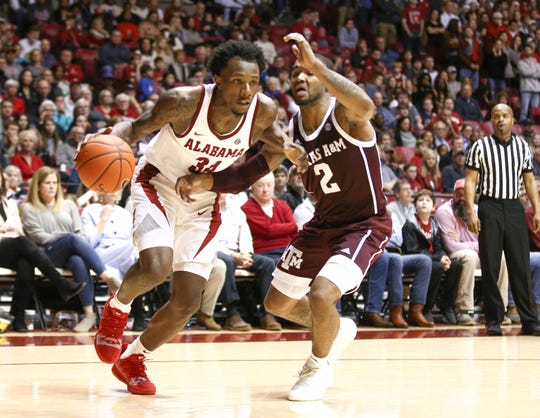 Jan 12, 2019; Tuscaloosa, AL, USA; Alabama Crimson Tide guard Tevin Mack (34) drives to the basket against Texas A&M Aggies guard TJ Starks (2) during the second half at Coleman Coliseum. Mandatory Credit: Marvin Gentry-USA TODAY Sports