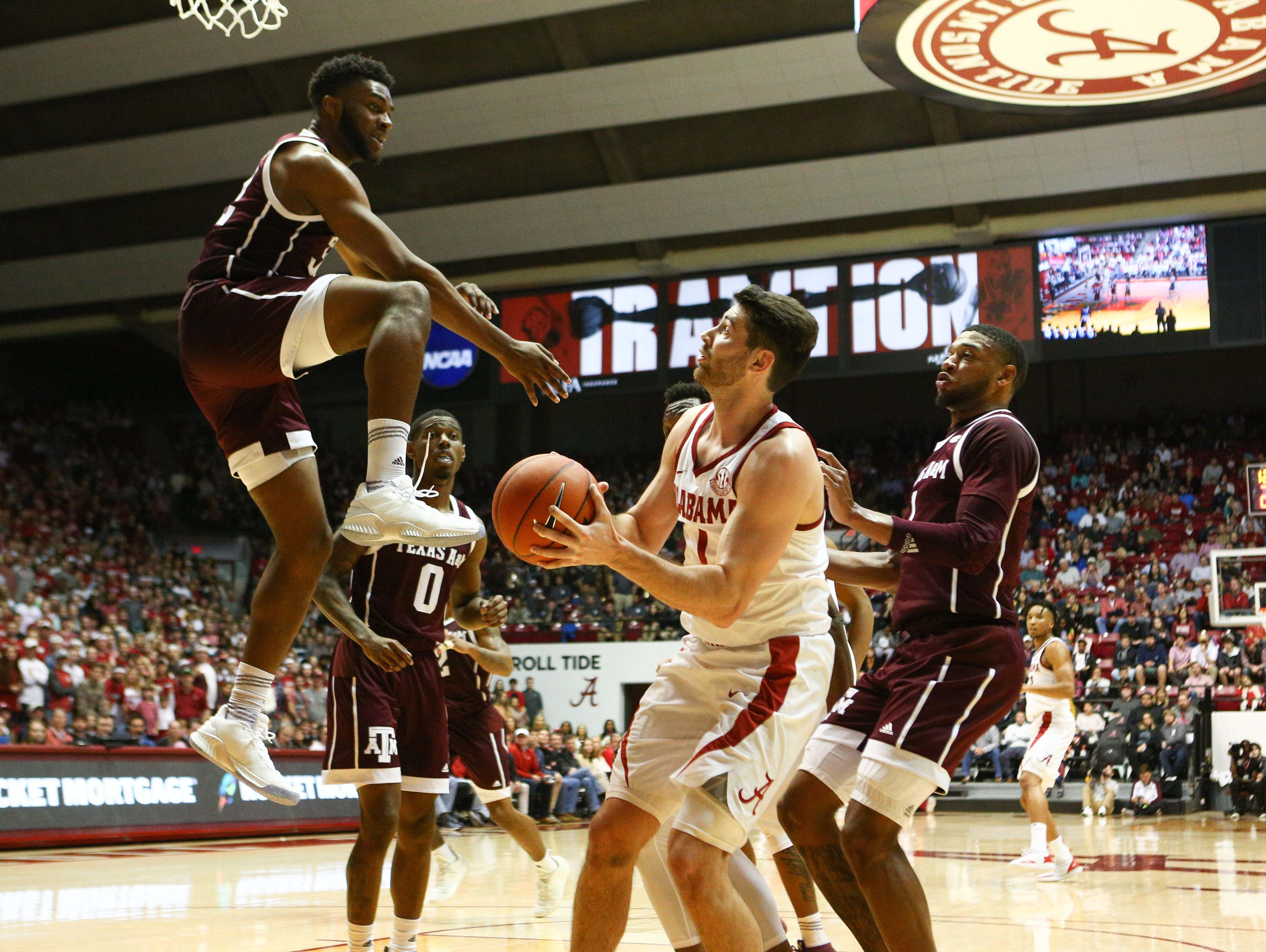 Jan 12, 2019; Tuscaloosa, AL, USA; Texas A&M Aggies forward Josh Nebo (32) attempts to block the shot of Alabama Crimson Tide guard Riley Norris (1) during the second half at Coleman Coliseum. Mandatory Credit: Marvin Gentry-USA TODAY Sports