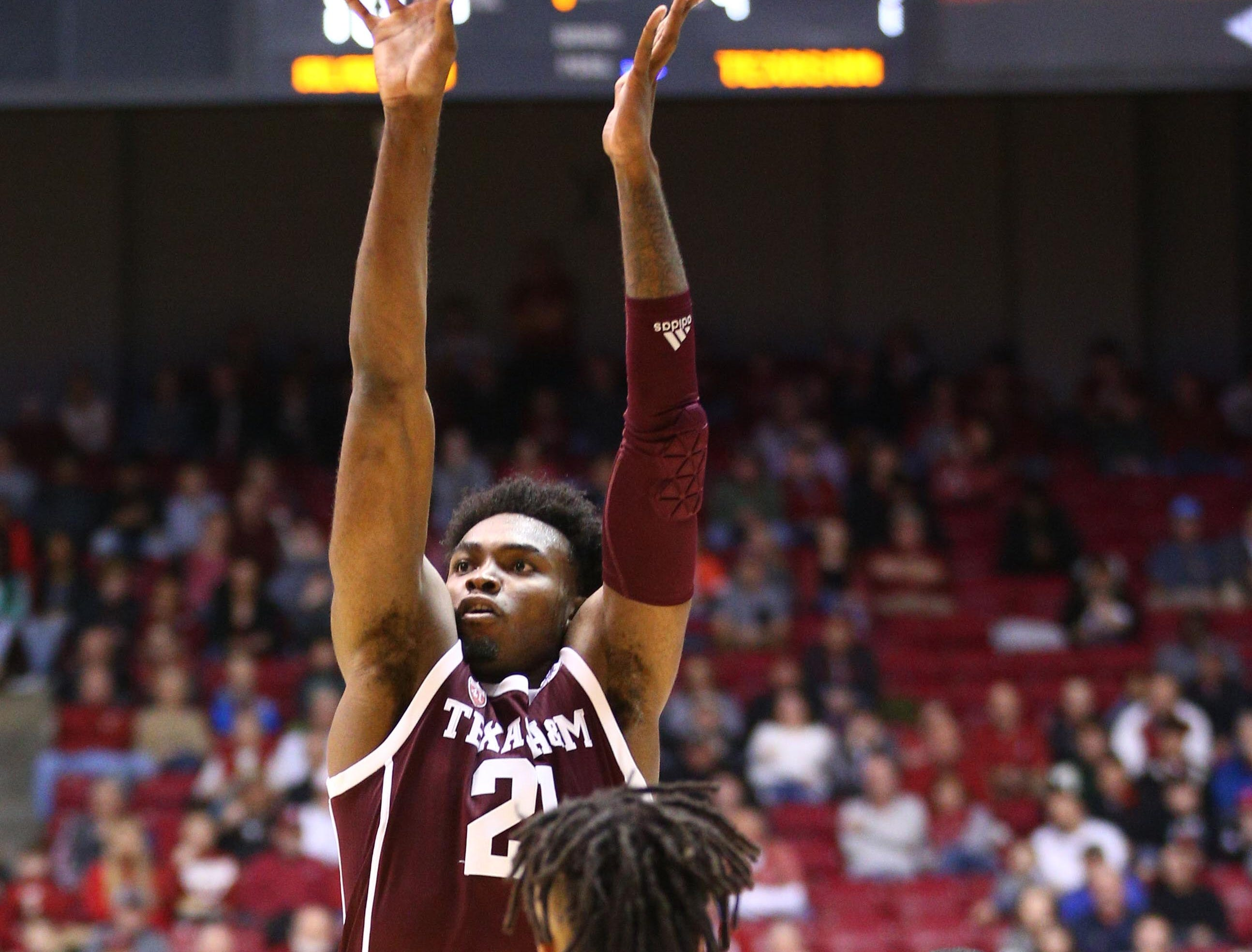 Jan 12, 2019; Tuscaloosa, AL, USA; Texas A&M Aggies forward Christian Mekowulu (21) shoots against Alabama Crimson Tide guard Dazon Ingram (12) during the first half at Coleman Coliseum. Mandatory Credit: Marvin Gentry-USA TODAY Sports