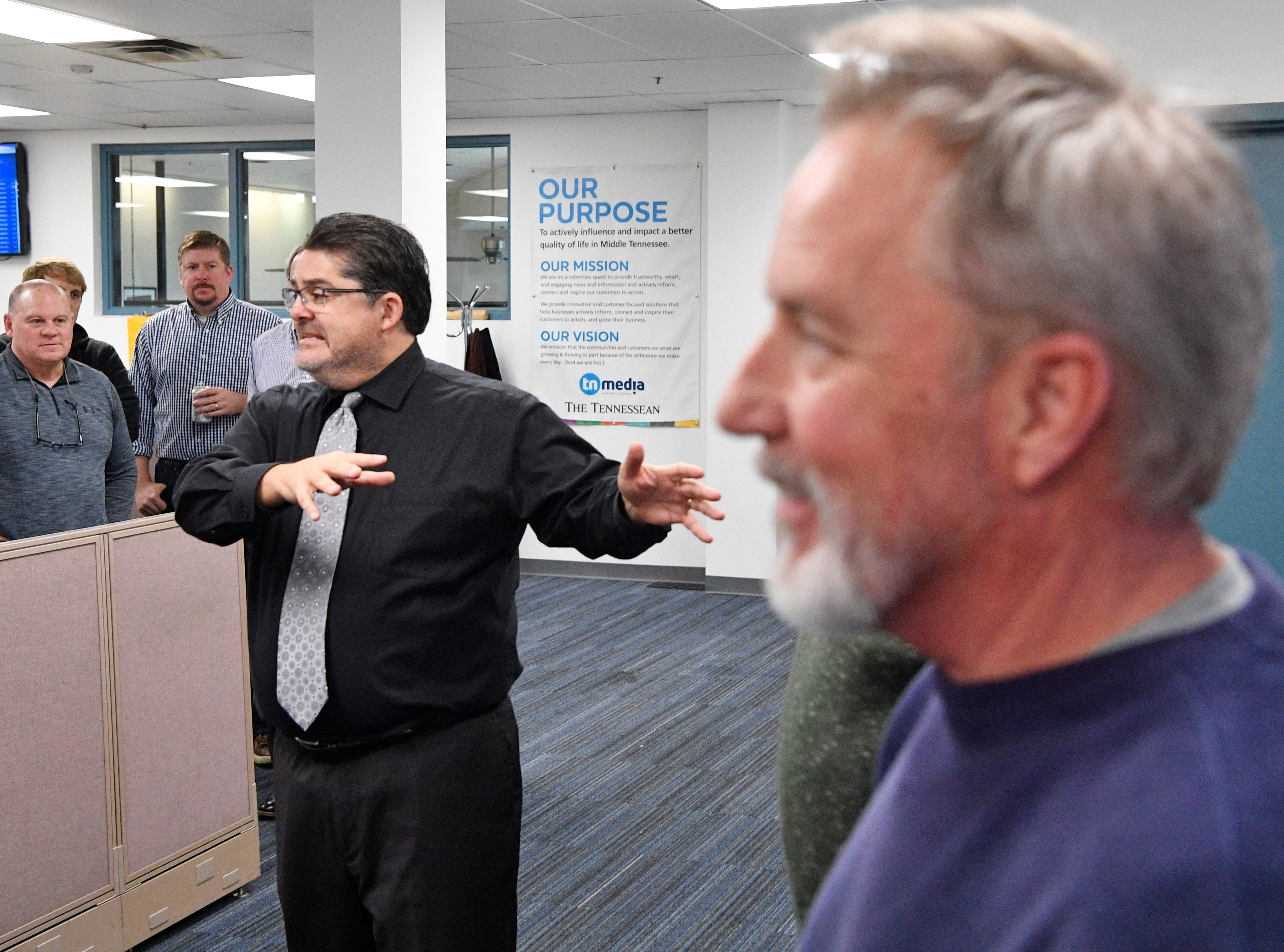 Editor Michael Anastasi speaks about Kent Travis during Travis' retirement party in The Tennessean newsroom Wednesday, Jan. 2, 2019.