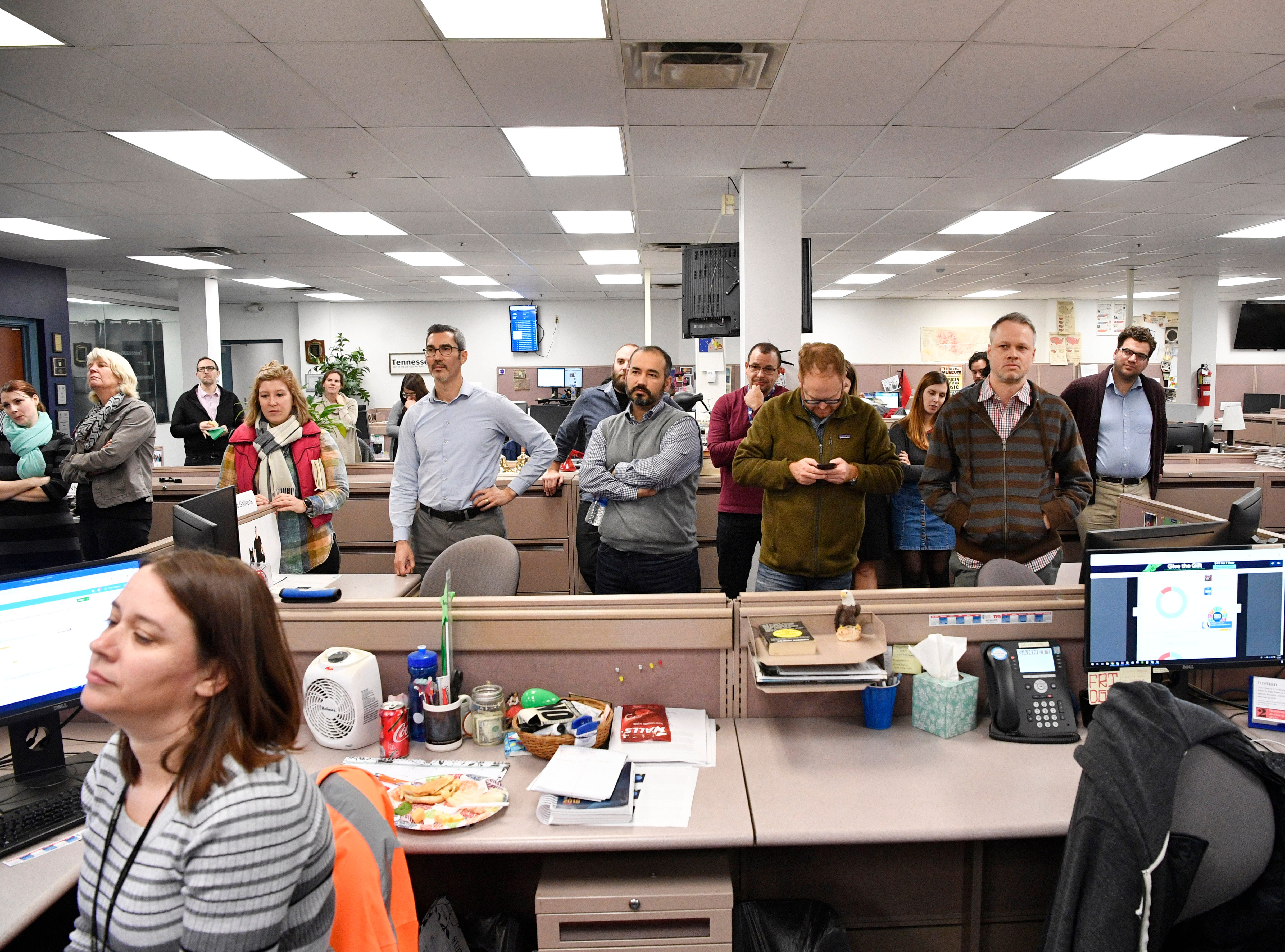 Staff members gather for the retirement party of Kent Travis and Jeff Walter in The Tennessean newsroom Wednesday, Jan. 2, 2019.