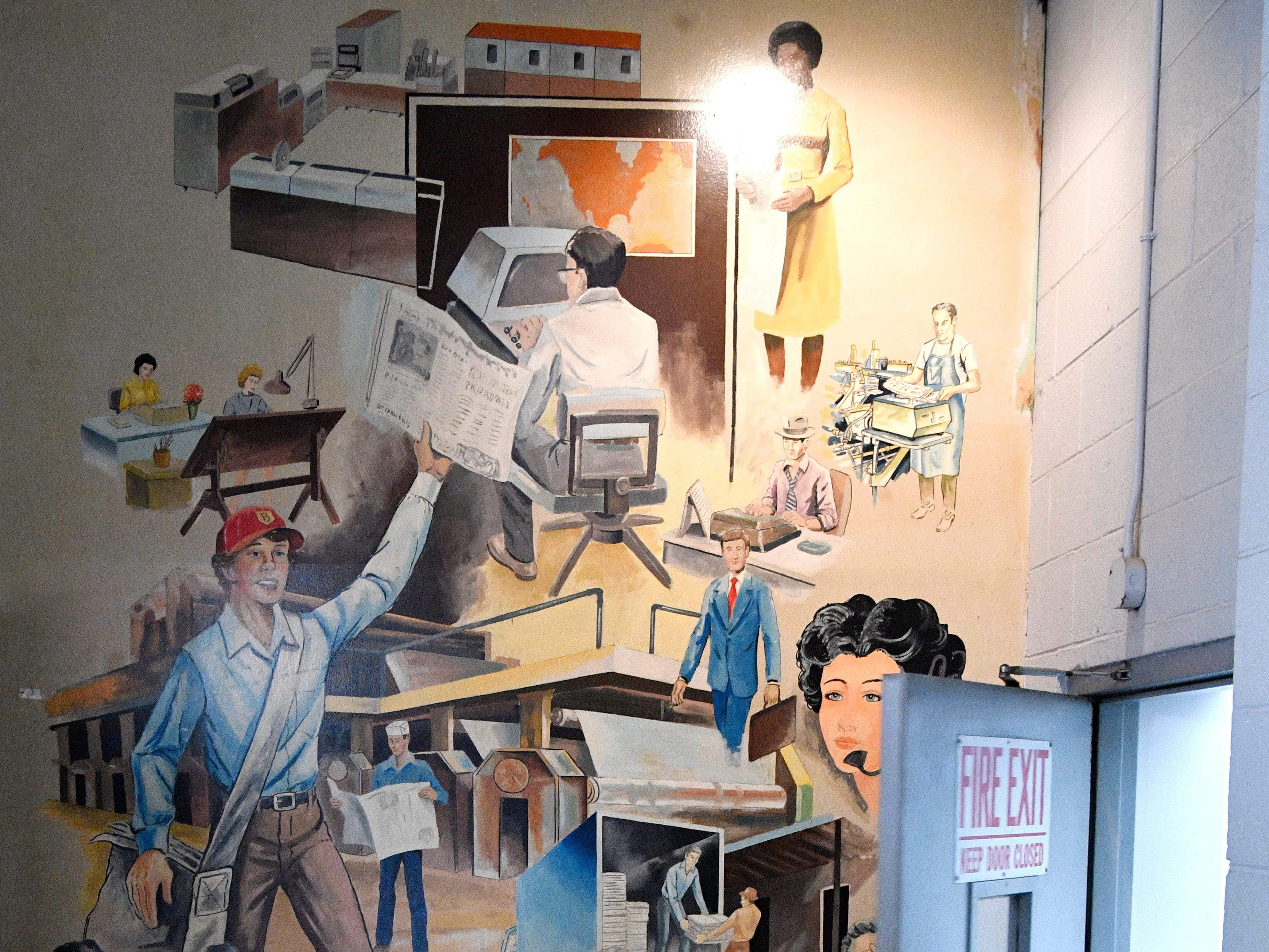 A mural on the third floor at 1100 Broadway depicts the newspaper community of the Tennessean and the Nashville Banner in a long-ago era.