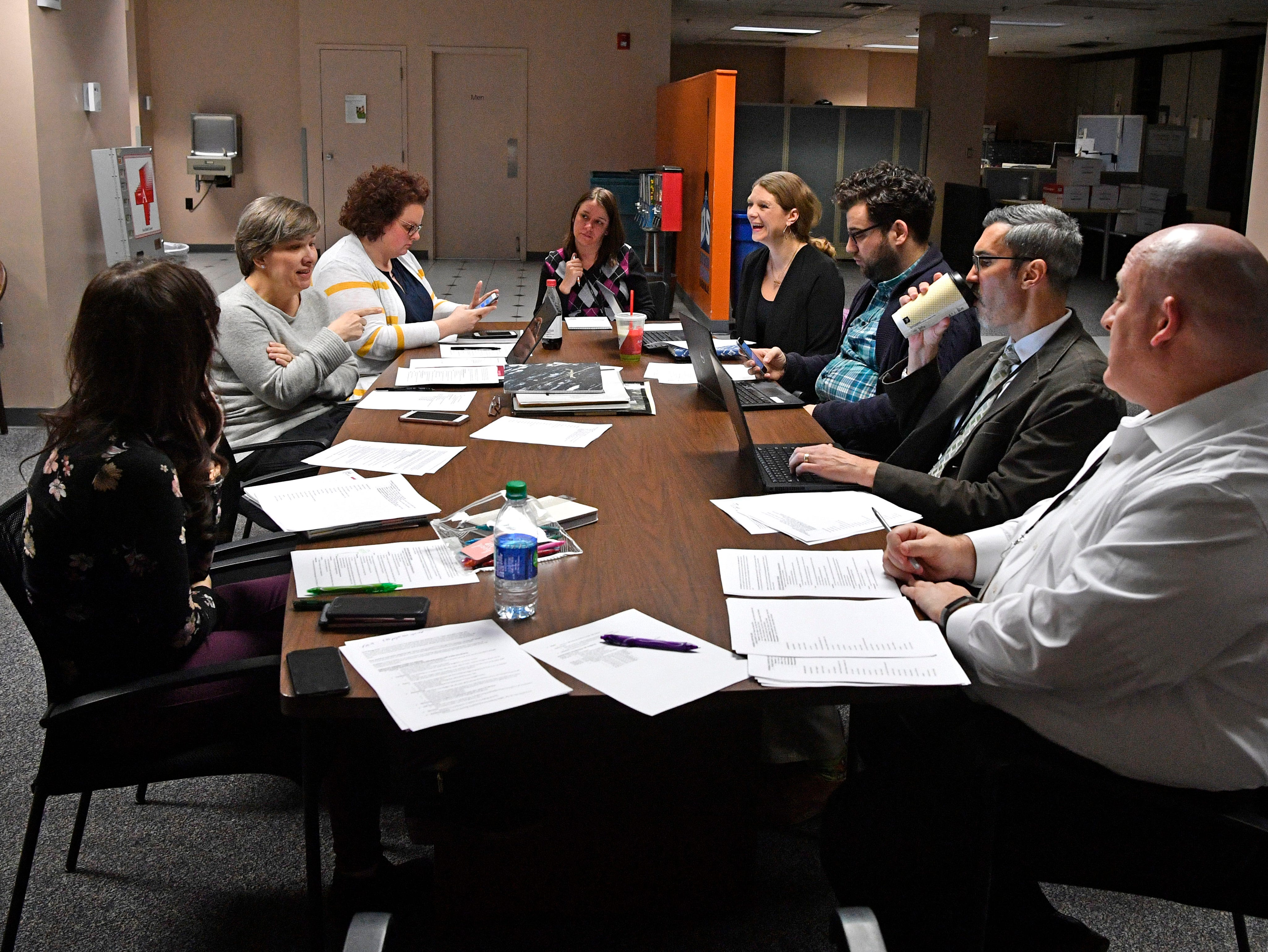 Members of the 1100 Broadway party planning committee work out the details Wednesday, Jan. 16, 2019, in Nashville.