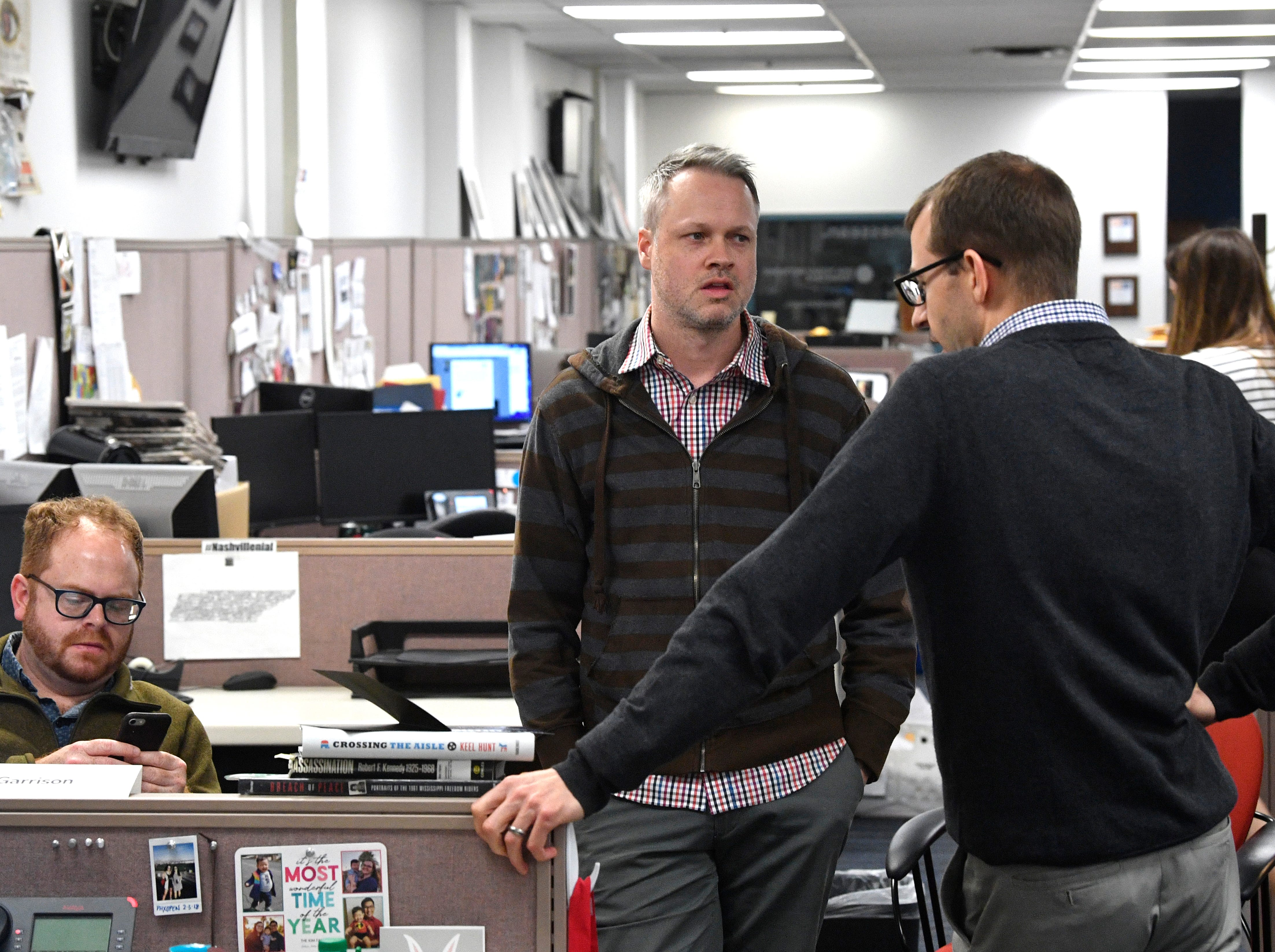 Content Strategist Duane Gang, left, talks with reporters Nate Rau and Joey Garrison in The Tennessean newsroom Wednesday, Jan. 2, 2019, in Nashville.