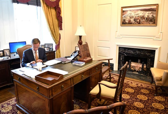 Between meetings Gov. Bill Haslam gets some work done in his private office at the Tennessee state CapitolTuesday Jan. 23, 2018, in Nashville, Tenn