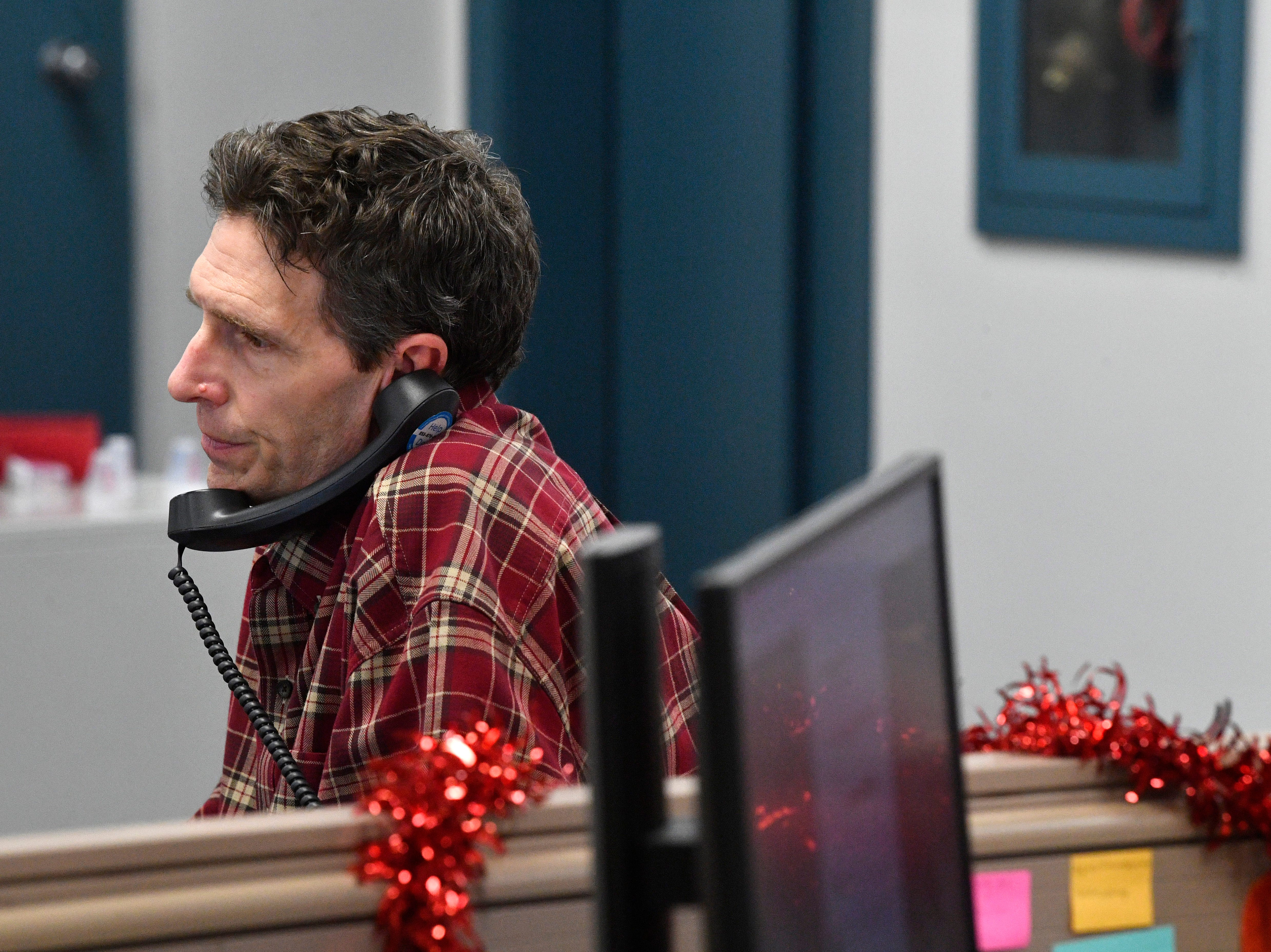 Wilson County reporter Andy Humbles takes a call in The Tennessean newsroom Wednesday, Jan. 2, 2019, in Nashville.