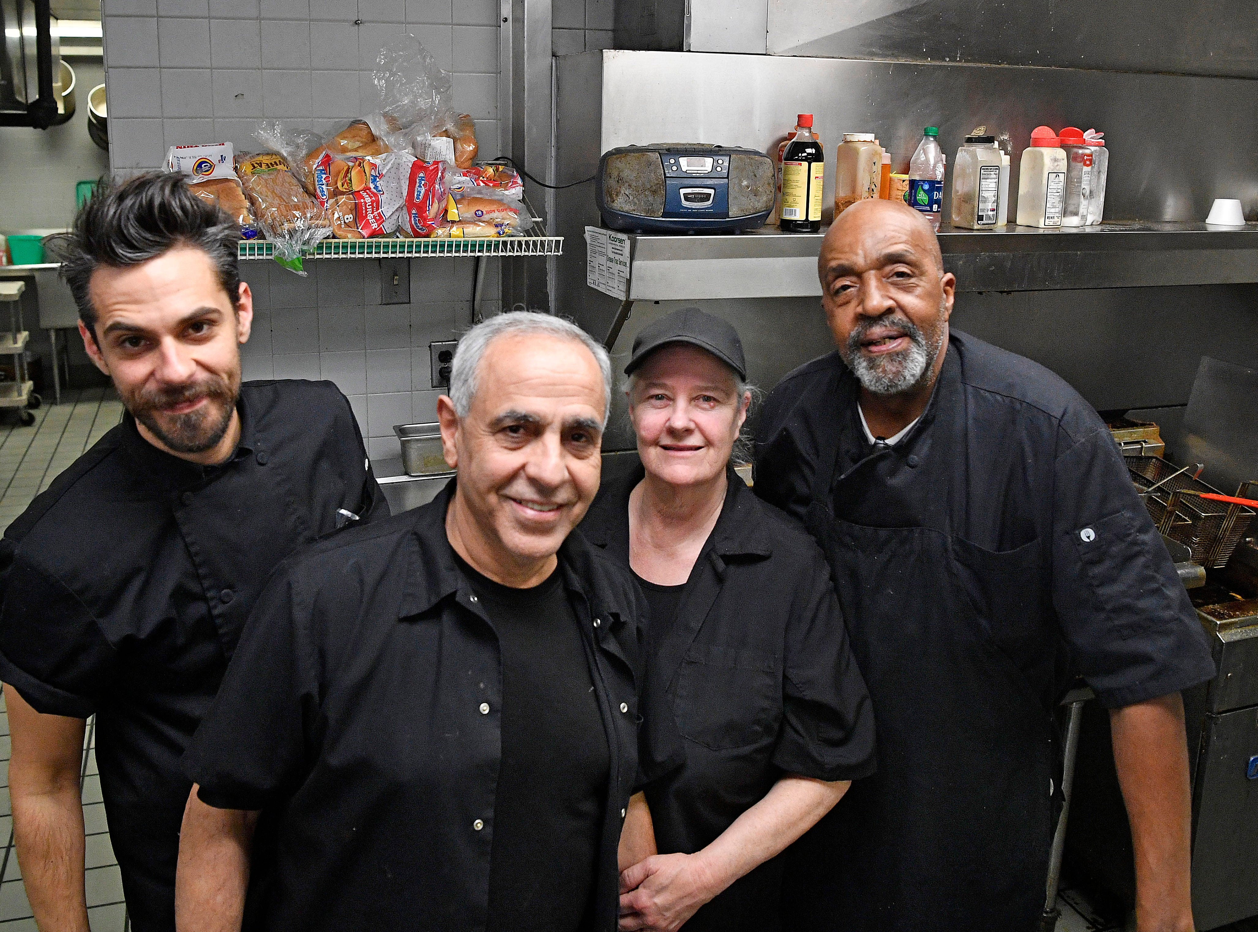 """Michael, """"Mo"""" and Judy Pourviseh and Winston Franklin have served in the cafeteria for years at 1100 Broadway."""