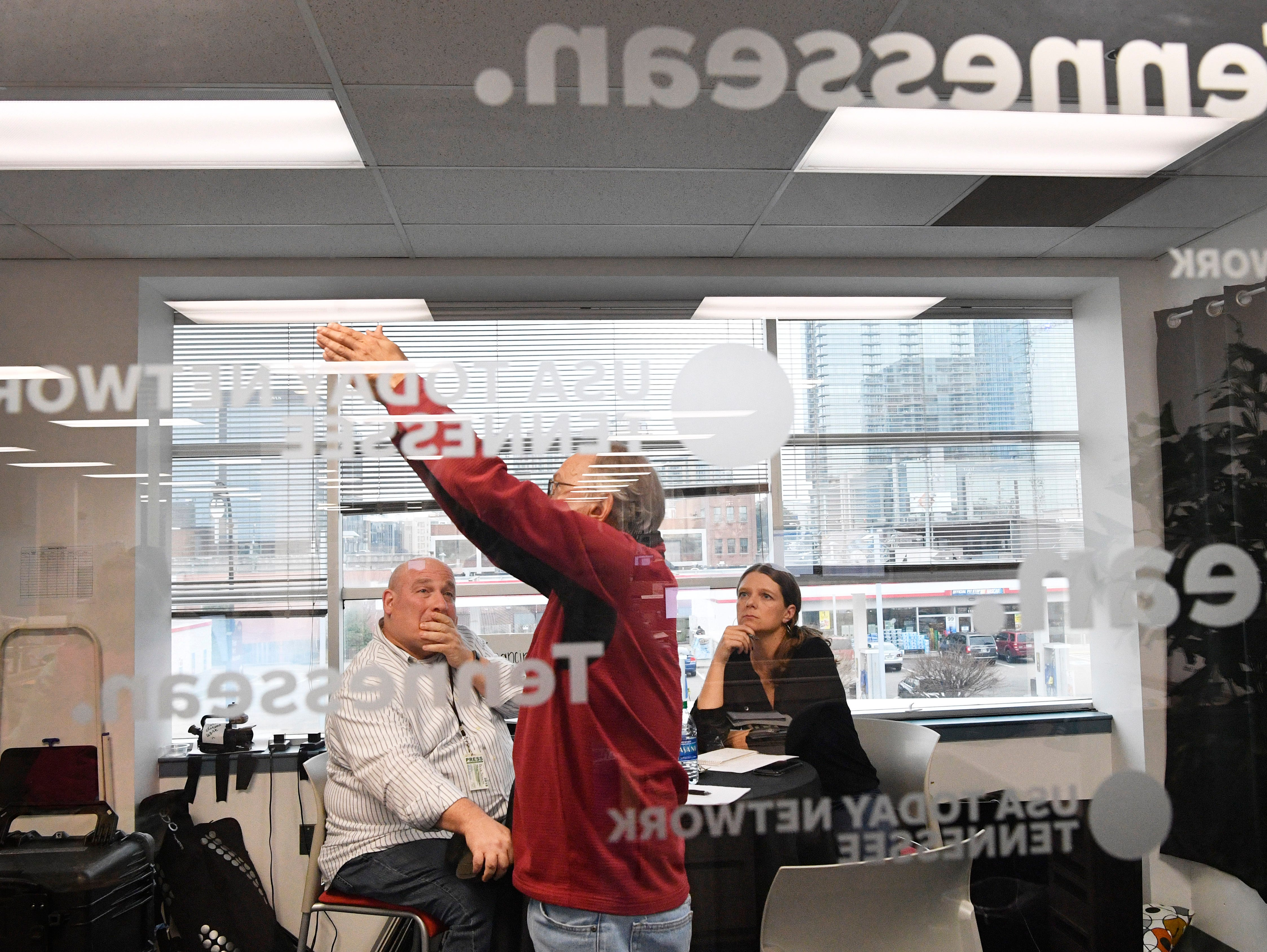 Brad Schmitt and Jessica Bliss interview a subject in The Tennessean newsroom Wednesday, Jan. 2, 2019.