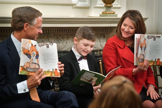 Gov. Bill Haslam and his wife Crissy take turns with ten-year-old Jackson Campbell reading a children's book for the board of the Governor's Books from Birth Foundation membersTuesday Jan. 23, 2018, in Nashville, Tenn