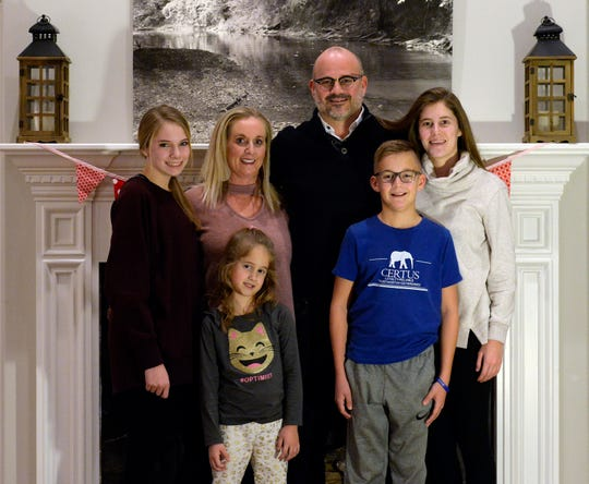 Family counselor Jason Gibson and his wife, Julie, with their four children Julianna, 14, Jenna, 6, Jude 10 and Jalie, 16, at their home on Friday, Jan. 11, 2019, in Gallatin Tenn.