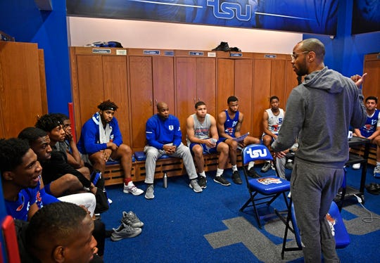 "TSU basketball coach, Brian ""Penny"" Collins, talks with his players in the locker room before practice