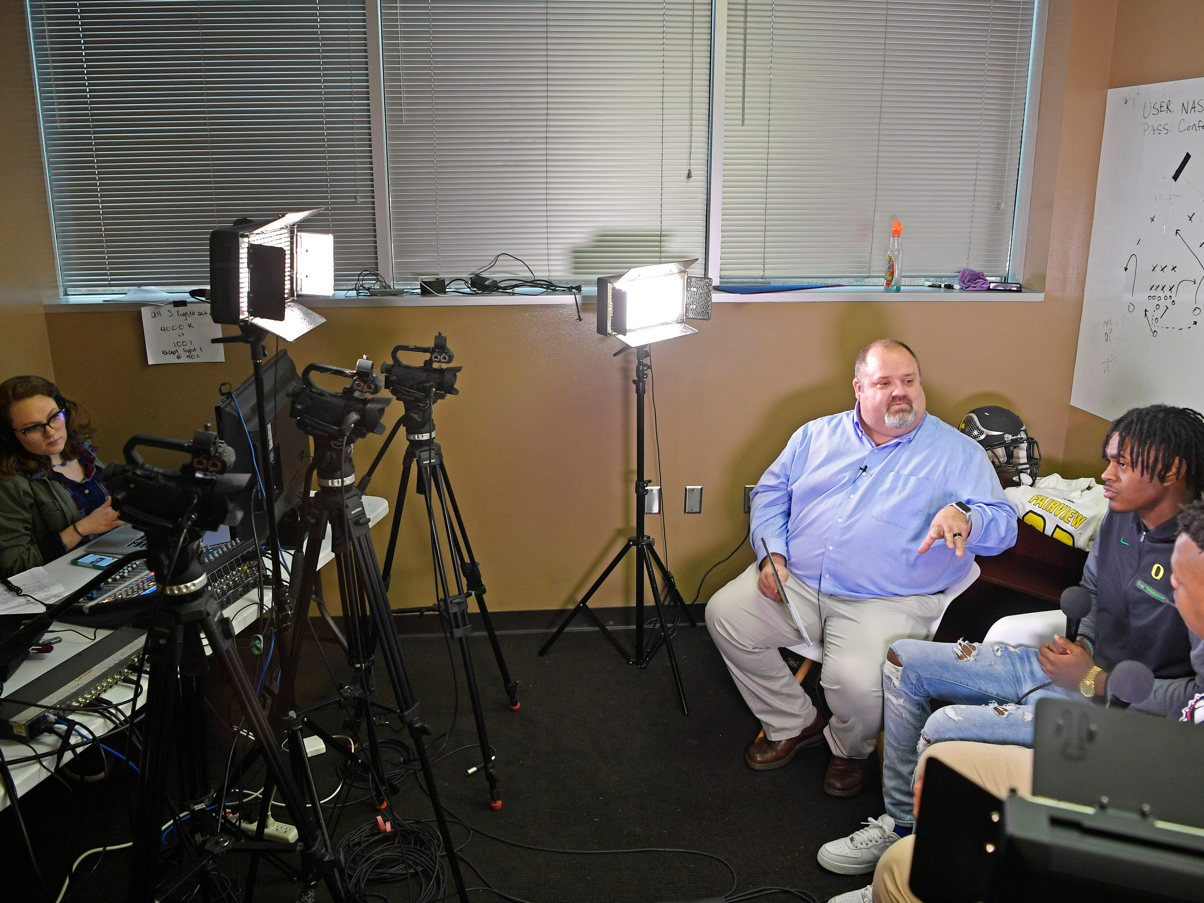 Autumn Allison records video as Tom Kreager interviews top high school football prospects in The Tennessean's newsroom Wednesday, Dec. 19, 2018, in Nashville.