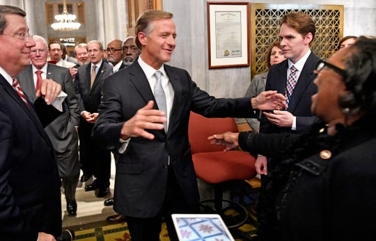 Governor Bill Haslam reaches out to hug Rep. Karen Camper, D-Memphis before he delivers his State of the State address at the Tennessee State Capitol Monday Jan. 29, 2018, in Nashville, Tenn