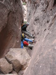 Louis Cicotello and his brother, David, free climbing the exit out of Robbers Roost Canyon in Utah in 2007.
