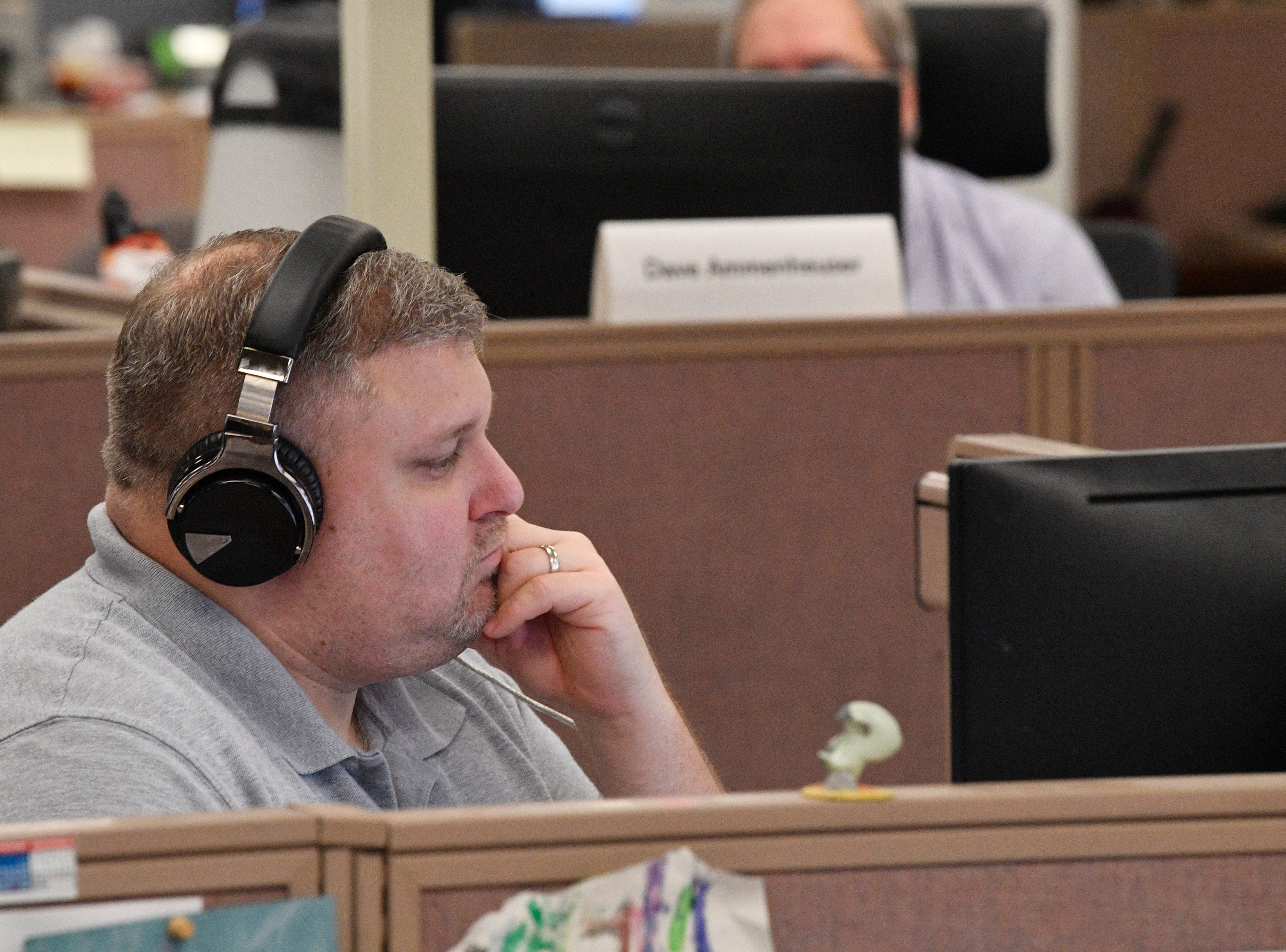 Producer Brian Minges works in The Tennessean newsroom Wednesday, Jan. 2, 2019.