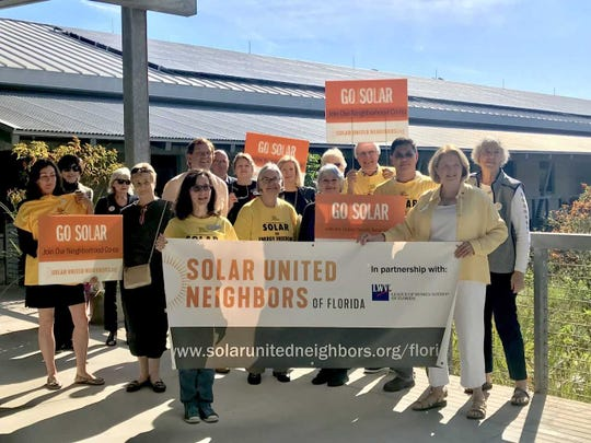 A group of supporters for a new Solar Co-op in Collier County pose for a group photo Jan. 17, 2019, at Naples Botanical Garden.