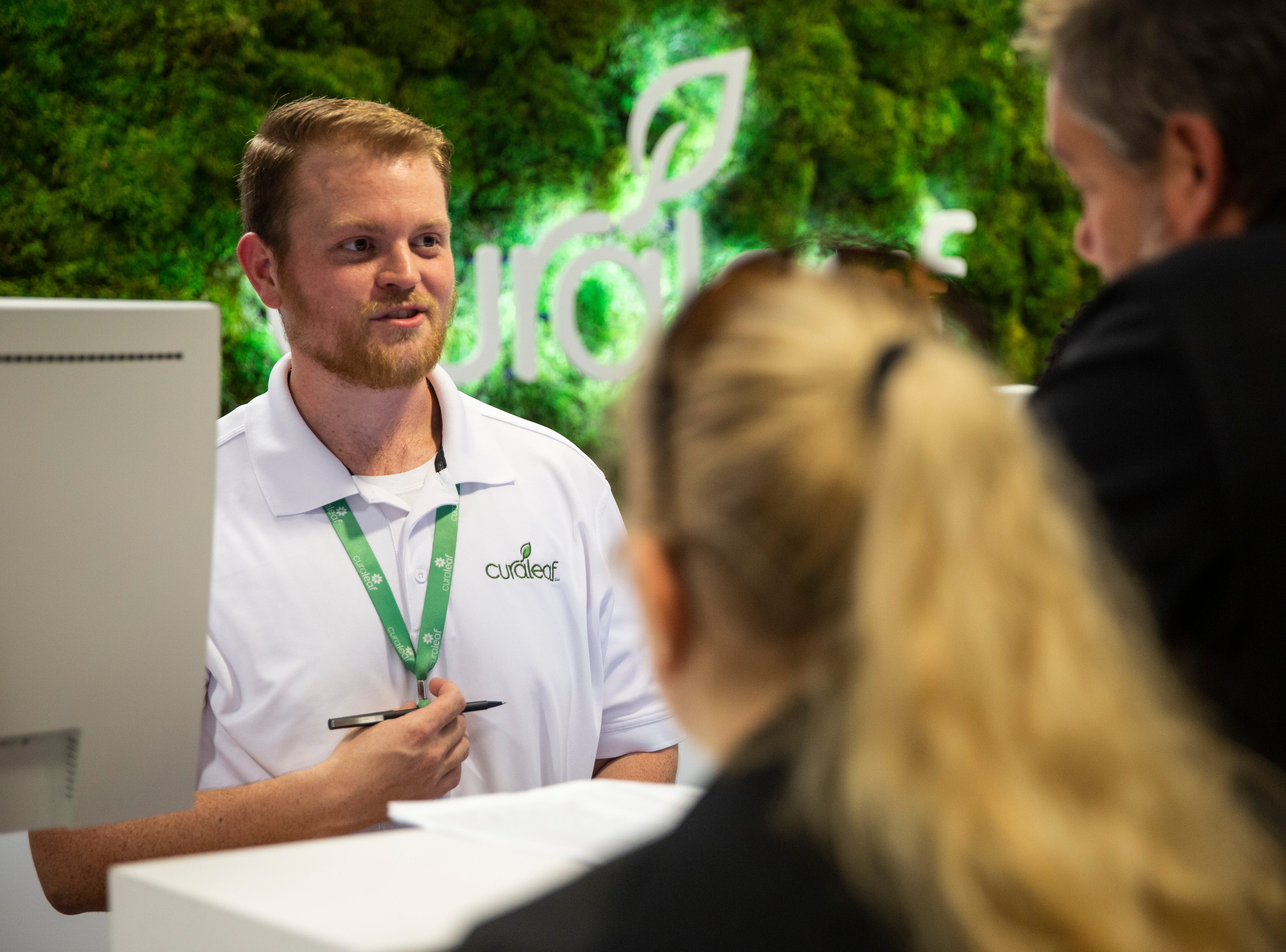 Chad Baker helps customers as they decide what products to buy during the grand opening of the Curaleaf medical marijuana dispensary in Bonita Springs on Thursday, January 17, 2019.