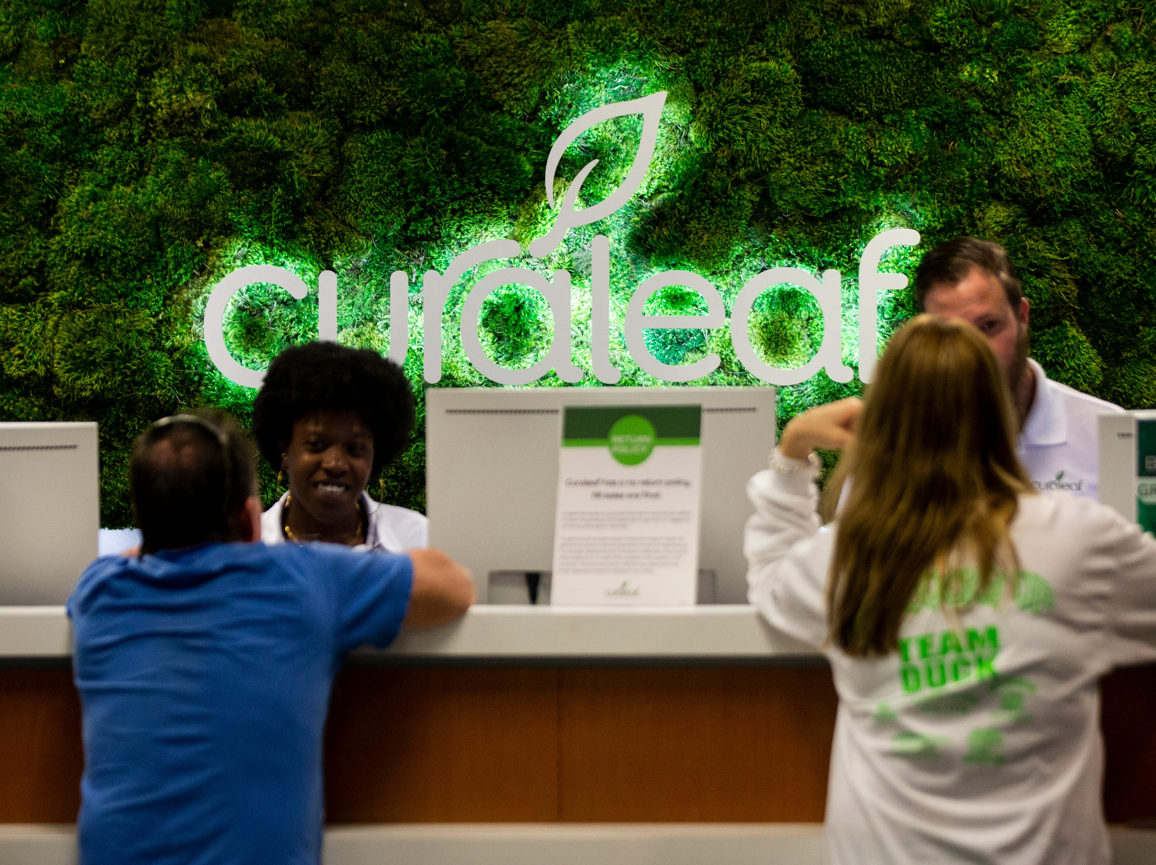Curaleaf employees help customers at the counter during the grand opening of the Curaleaf medical marijuana dispensary in Bonita Springs on Thursday, January 17, 2019. Curaleaf patients range in age from two years old to 102.
