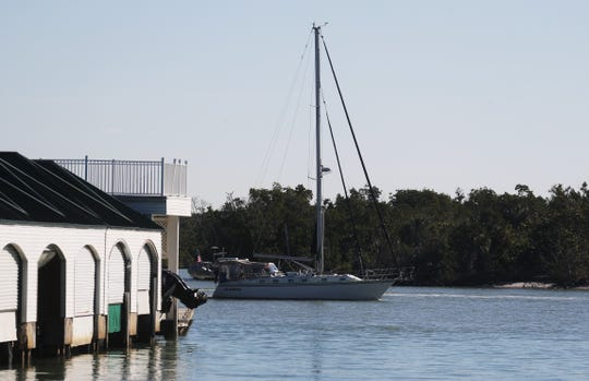 A boat moves through Gordon Pass in Naples on Wednesday 1/16/2019. Appropriation for the dredging of Gordon Pass has been pulled by the Army Corps of Engineers.
